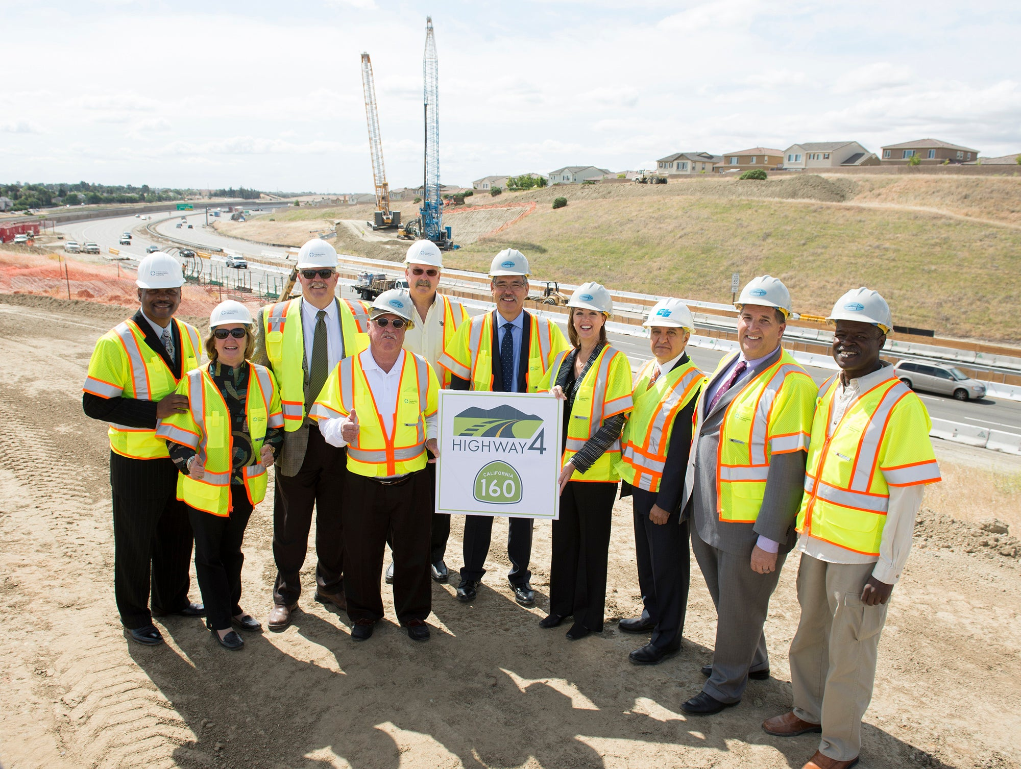Officials take part in the groundbreaking ceremony for the SR 160/Hwy. 4 direct connector ramps project.
