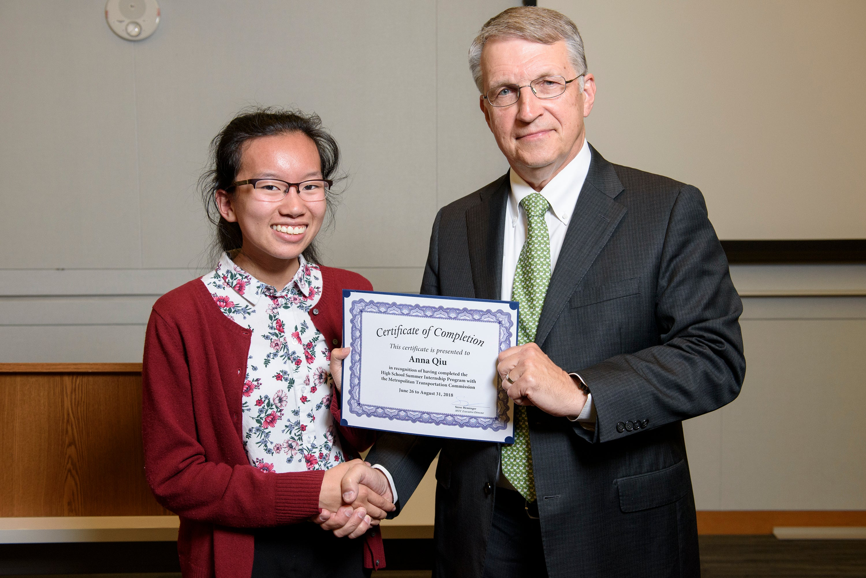 MTC high school intern Anna Qui receives her certificate for completing the program.