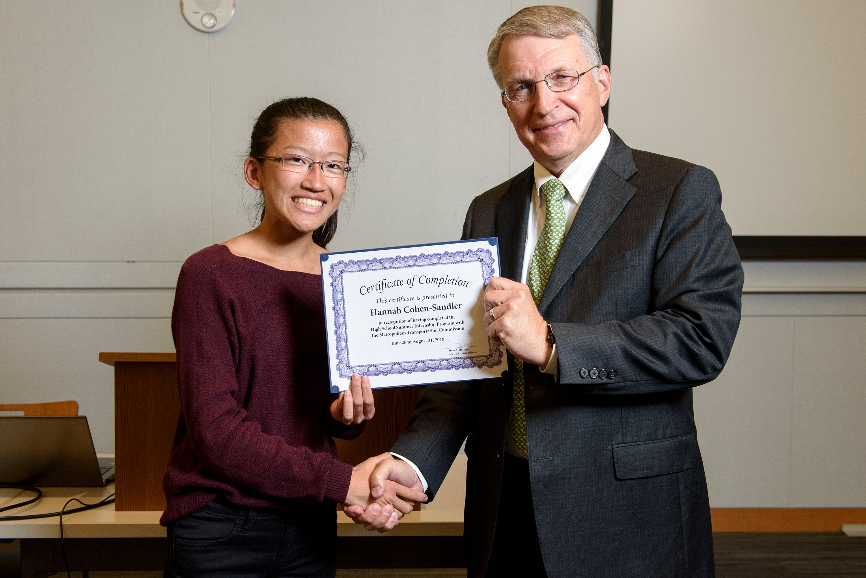 MTC high school intern Hannah Cohen-Sandler receives her certificate for completing the program.
