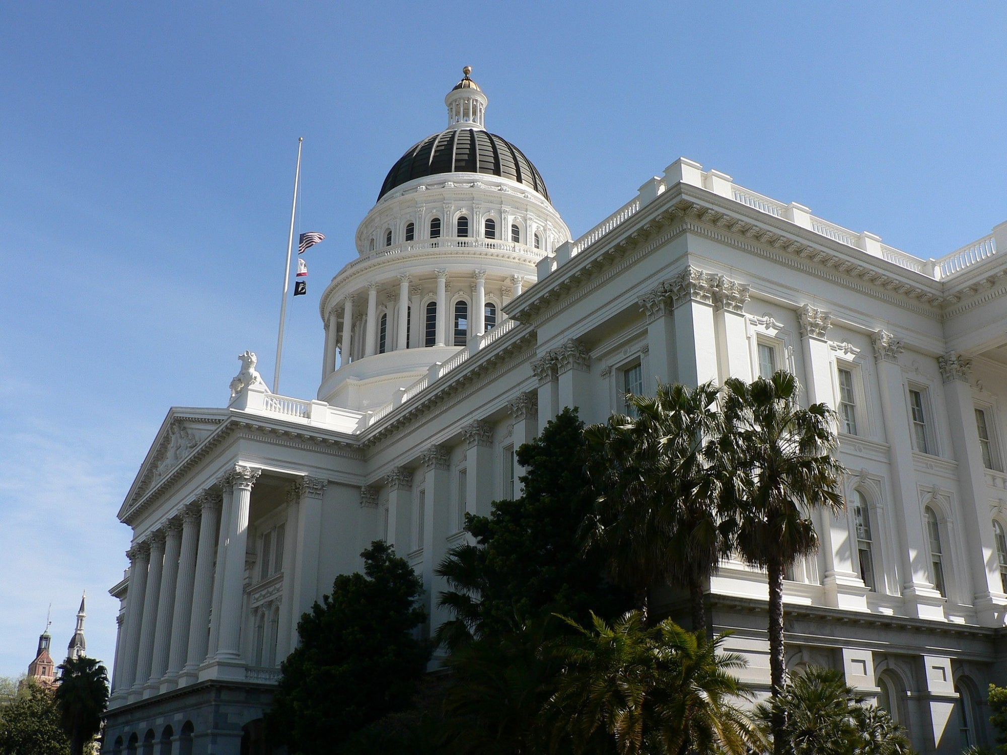 The California State Capitol building with blue skies in the background.