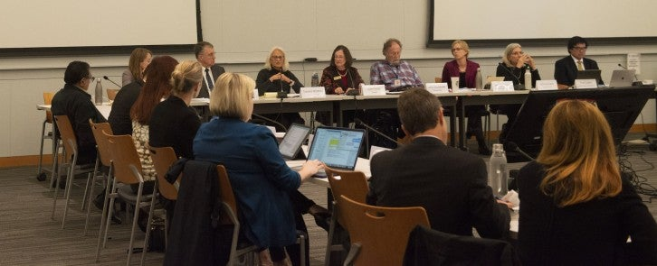 MTC staff and Housing Legislative Working Group members sit at tables in a rectangle in the Yerba Buena Meeting Room.