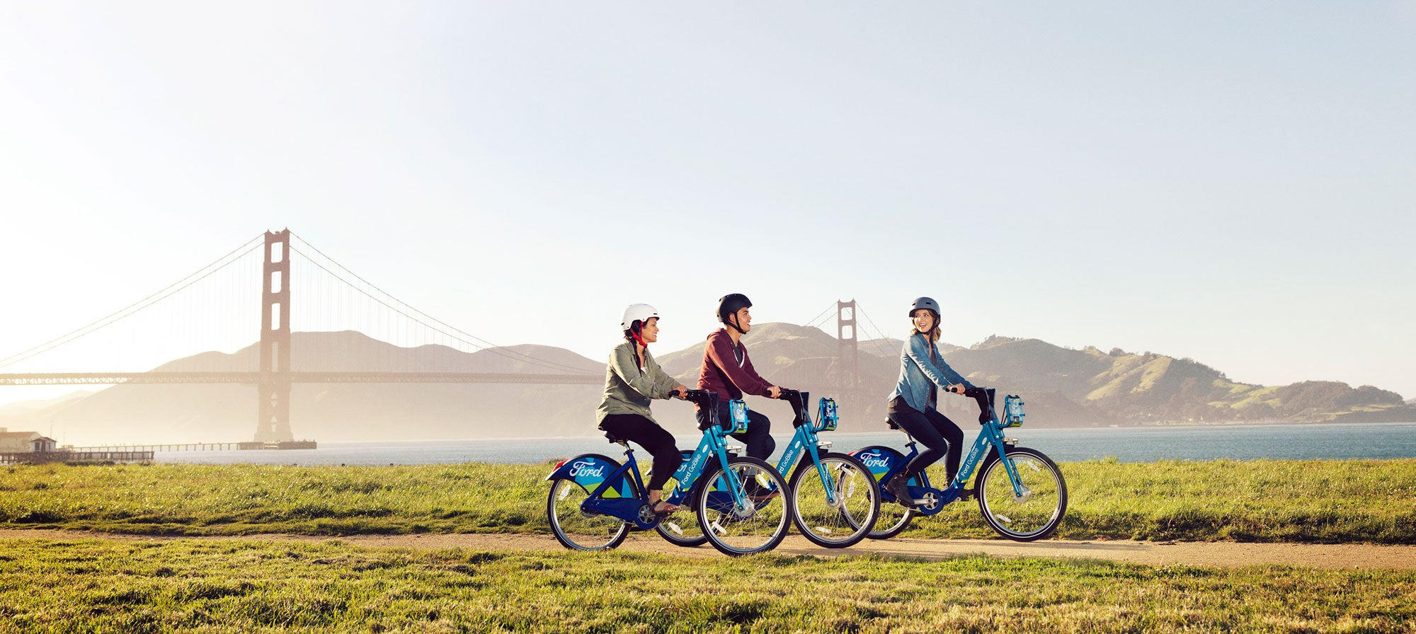 GoBike riders near the Golden Gate Bridge exchange pleasantries