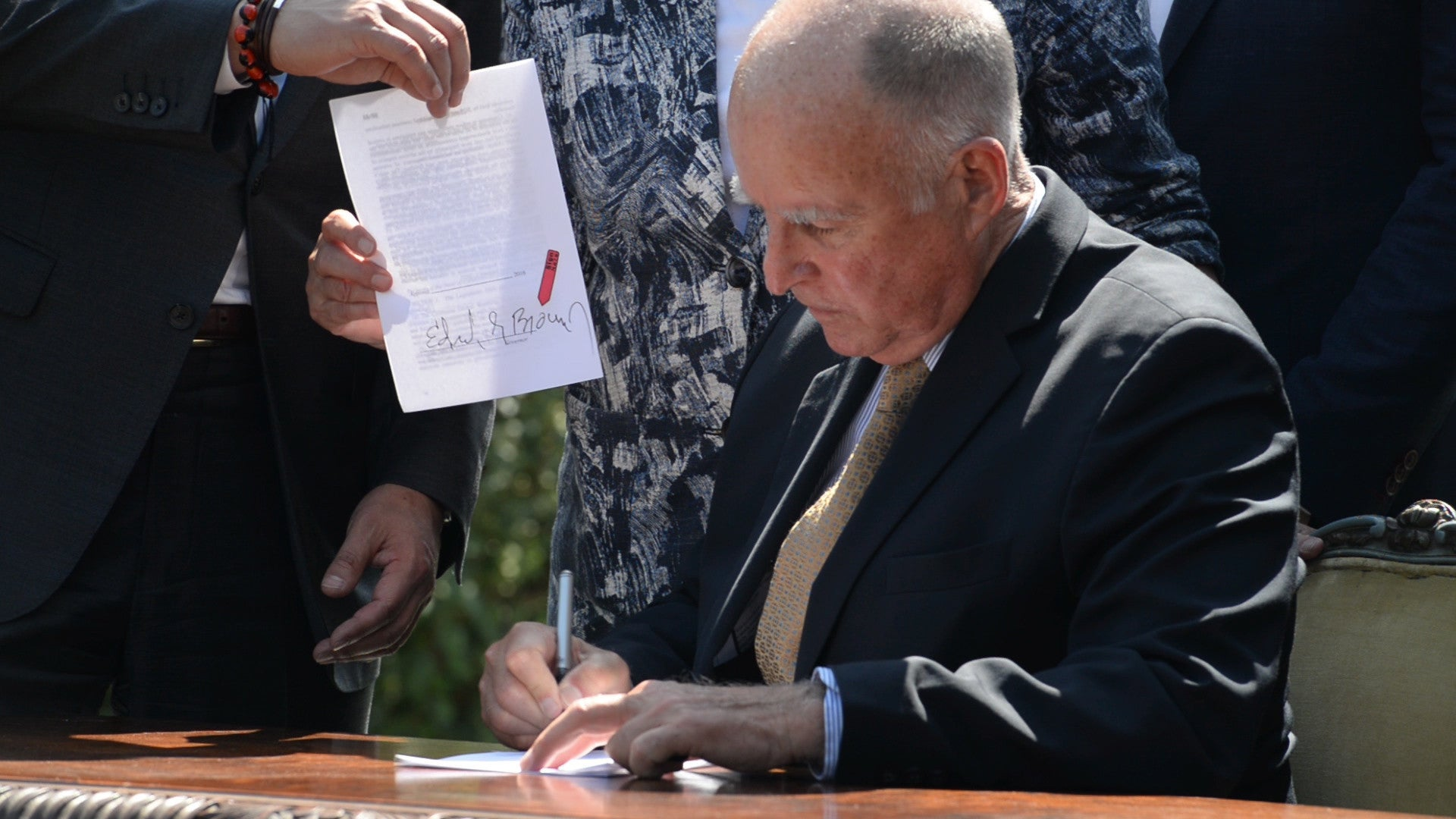 Governor Brown signing bills