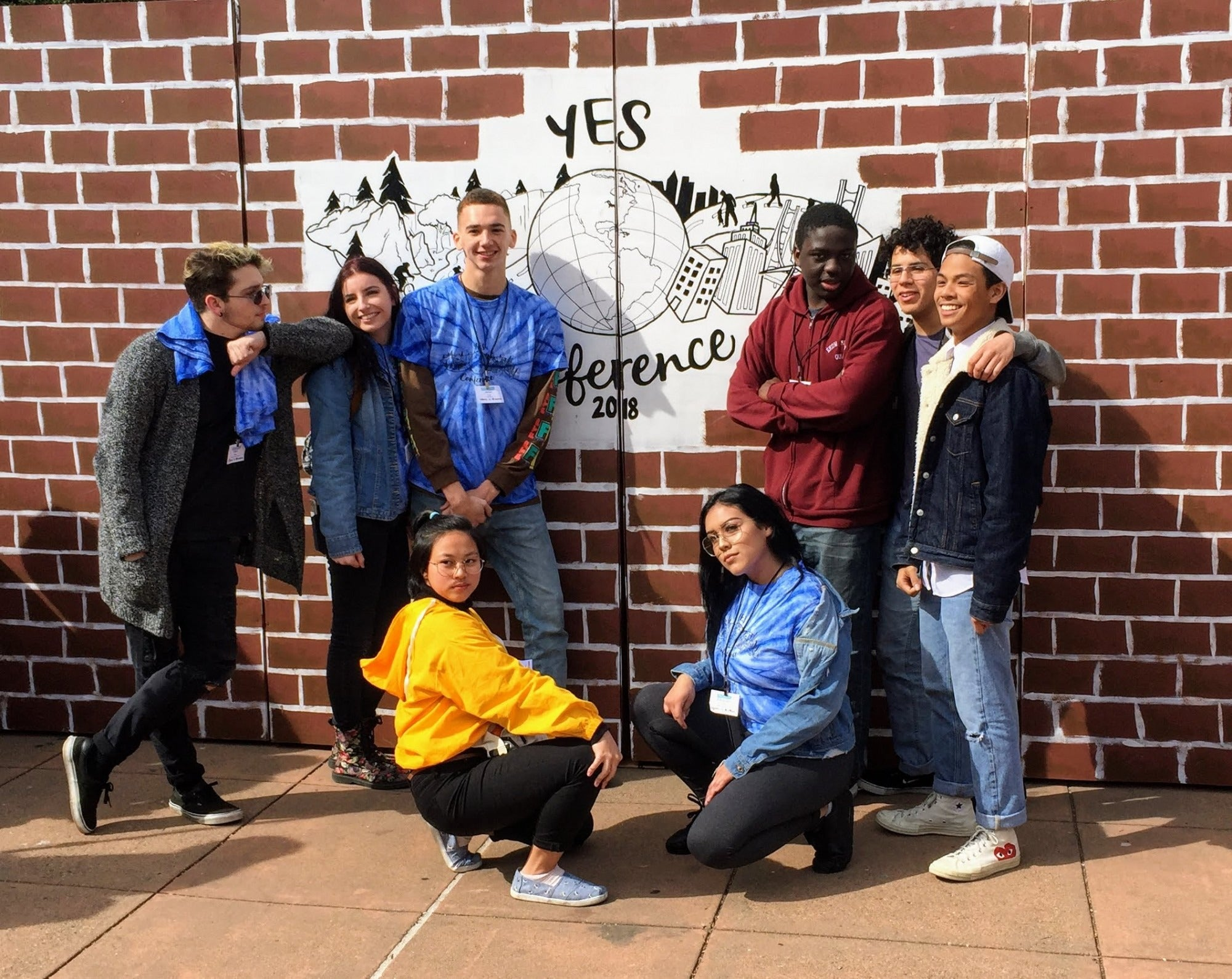 A group of 8 students pose at the 2018 YES Conference.