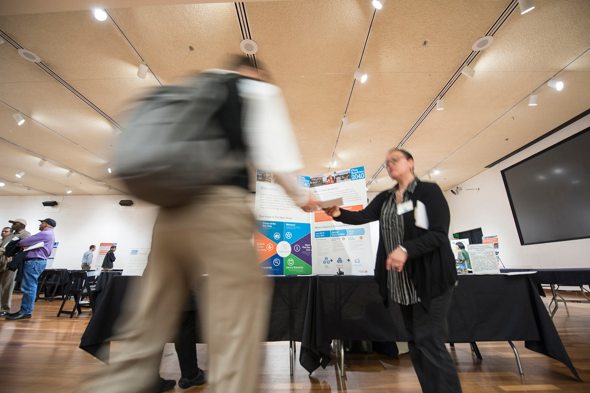 Two people shaking hands at an expo