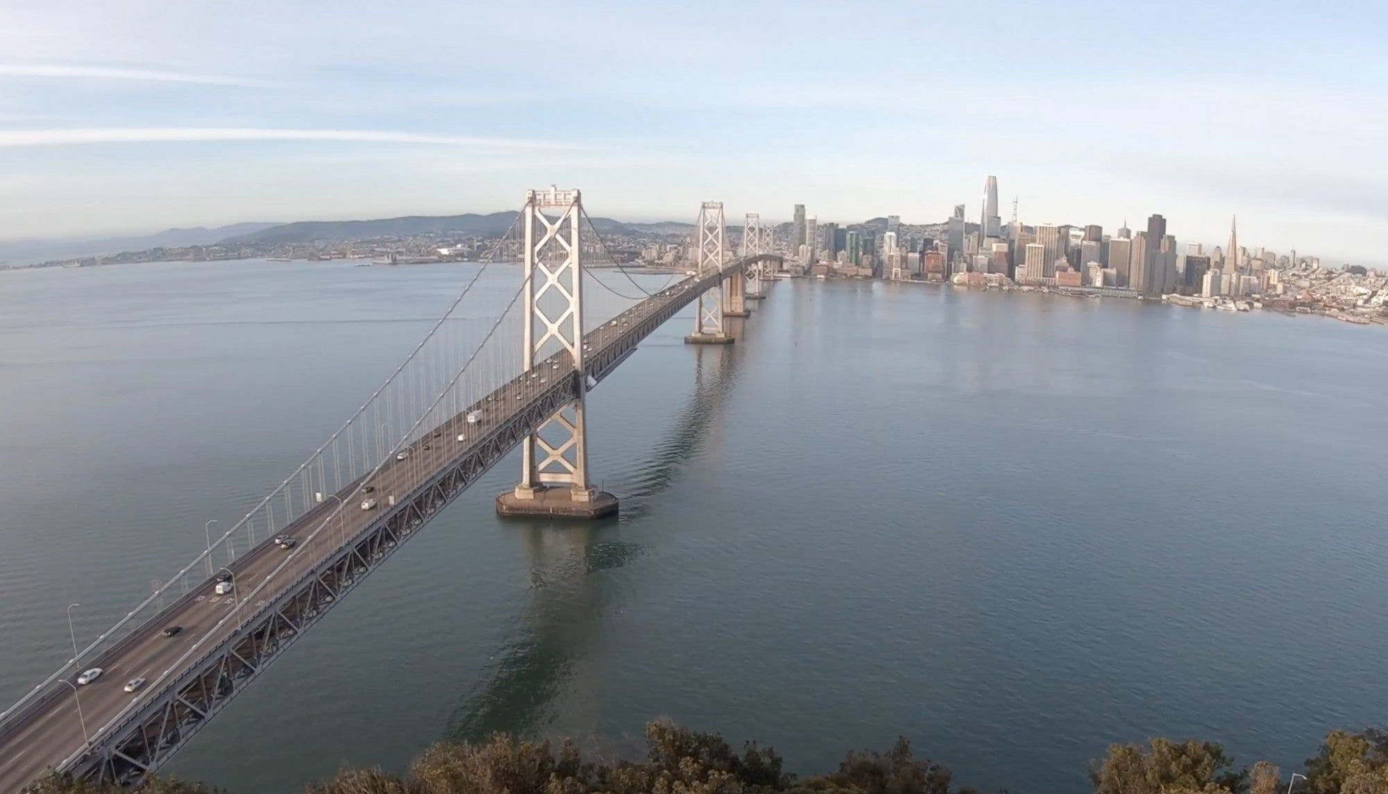 Aerial view of the San Francisco-Oakland Bay Bridge with very light traffic