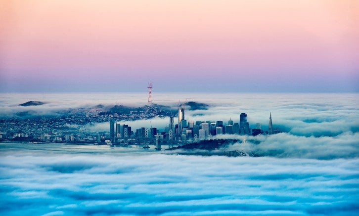 Fog surrounds San Francisco, where only downtown skyscrapers and the Sutro Tower are visible.