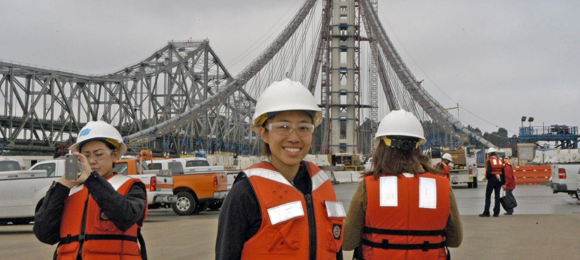 High school interns stand on the Bay Bridge.