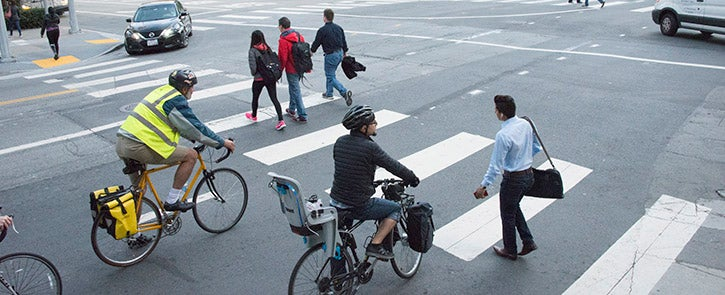Cyclists, pedestrians and vehicles at an intersection