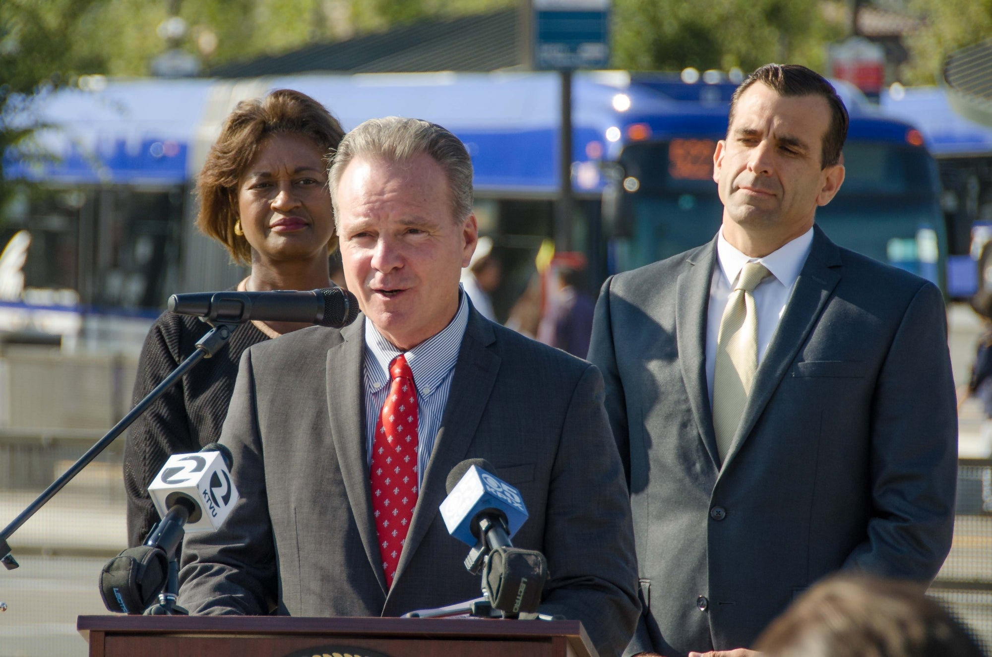 MTC Chair Dave Cortese speaks at the TRIP press conference, flanked by VTA General Manager Nuria Fernandez (left) and MTC Commissioner and San Jose Mayor Sam Liccardo (right).