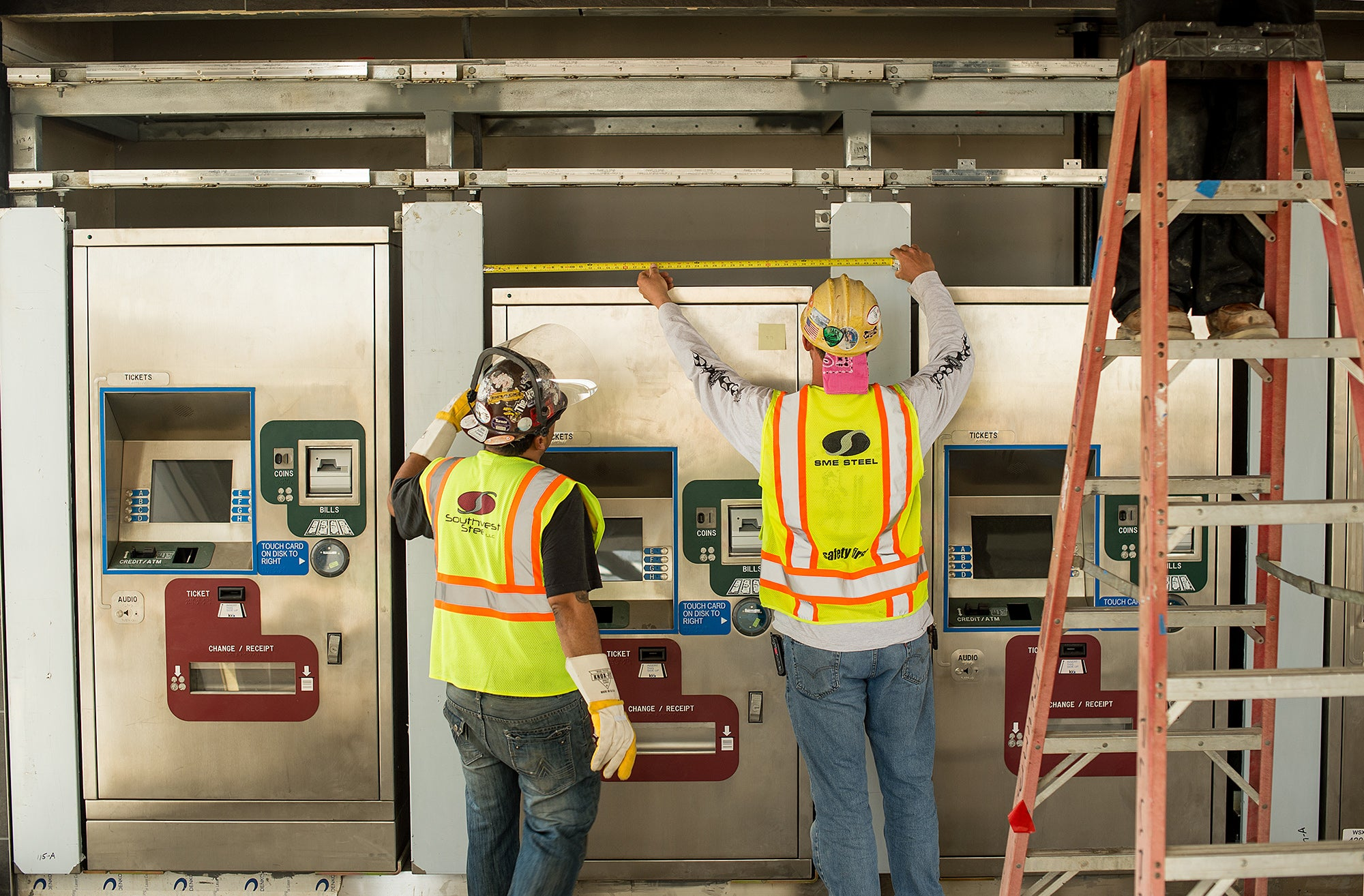 Warm Springs BART Station: Workers install ticket machines.