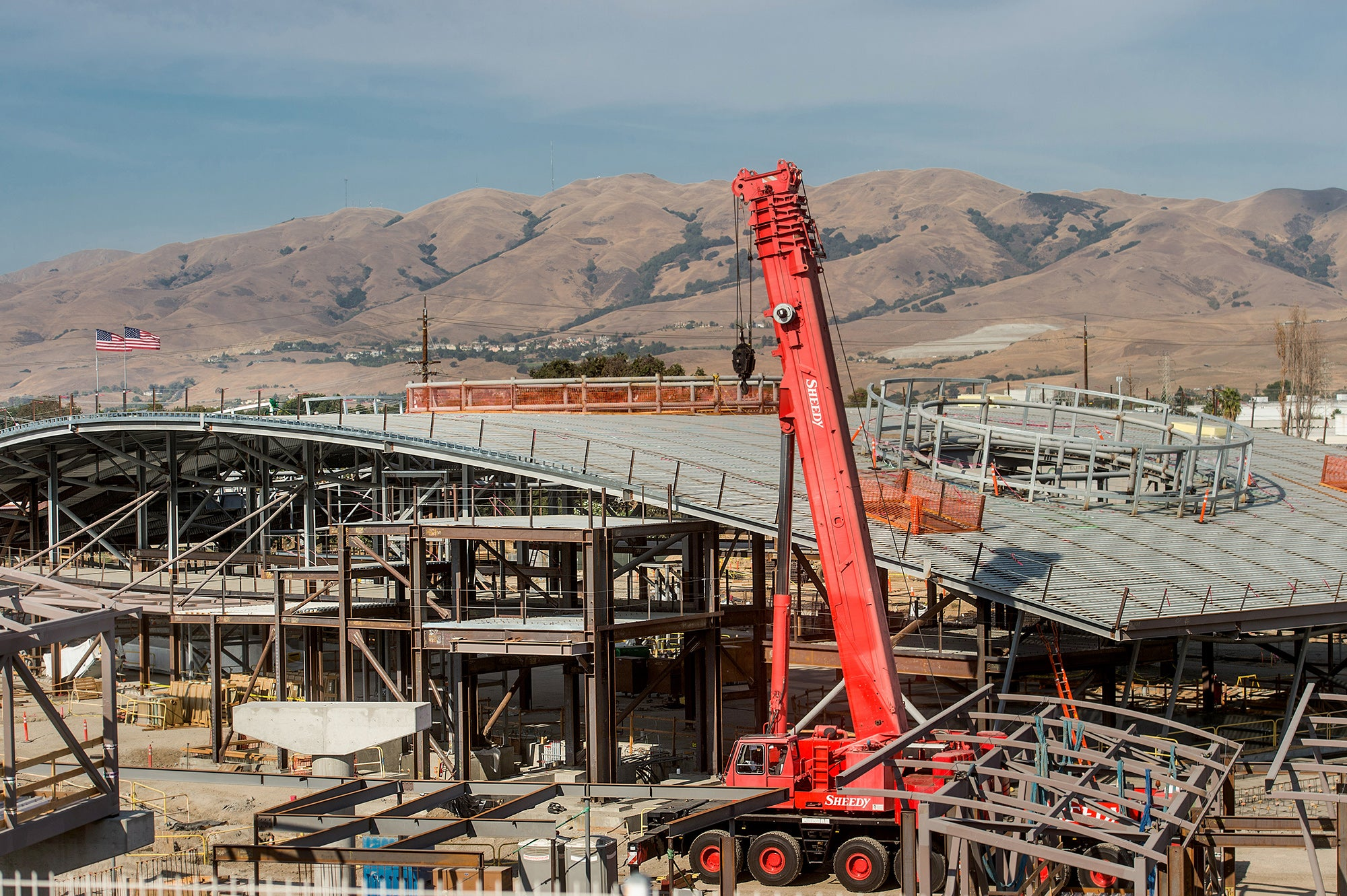 Milpitas BART Station: Crews work on the frame and roof of the station.