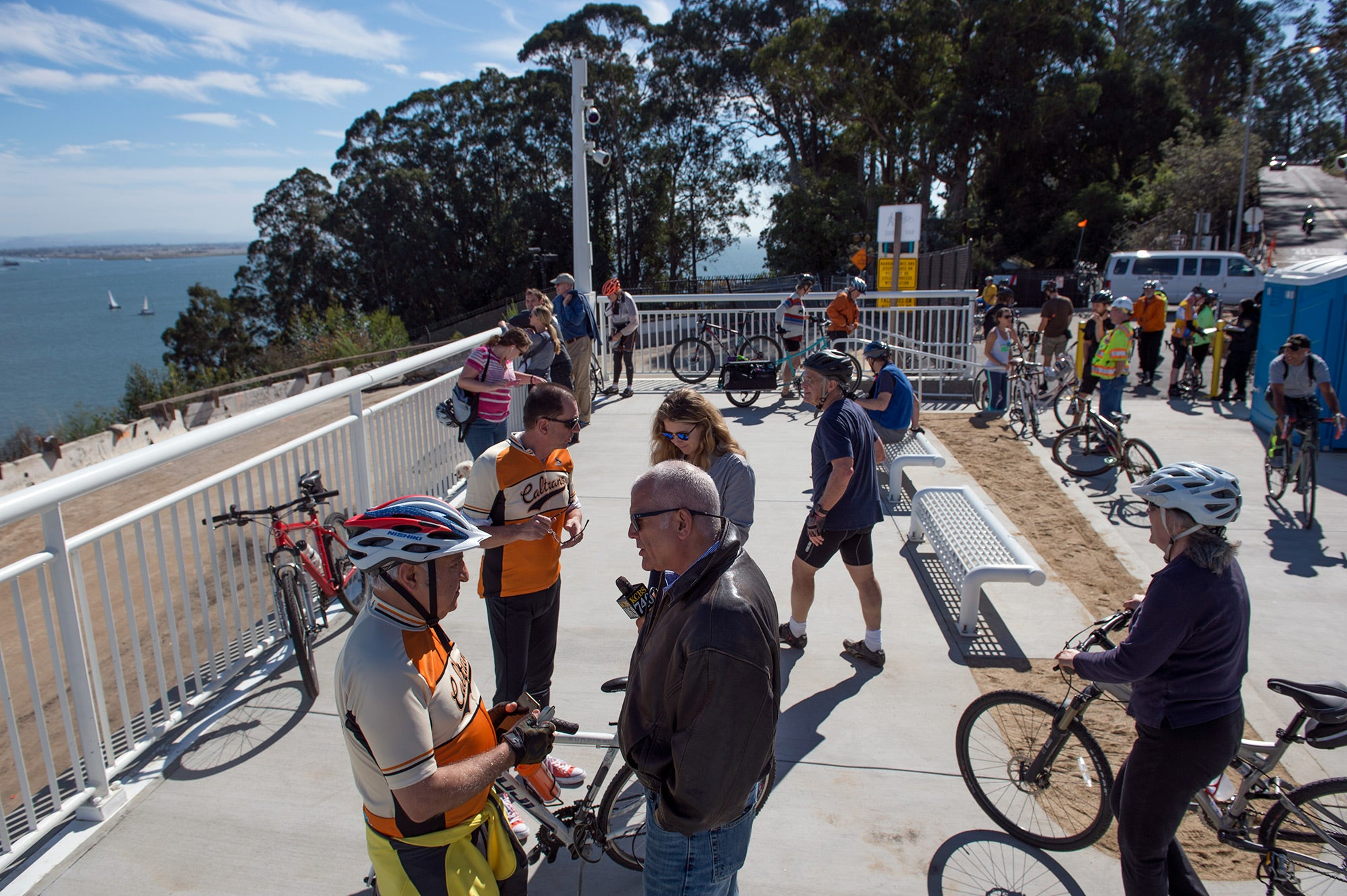 Curious and excited cyclists and hikers gather at the Yerba Buena Island touchdown on opening day.