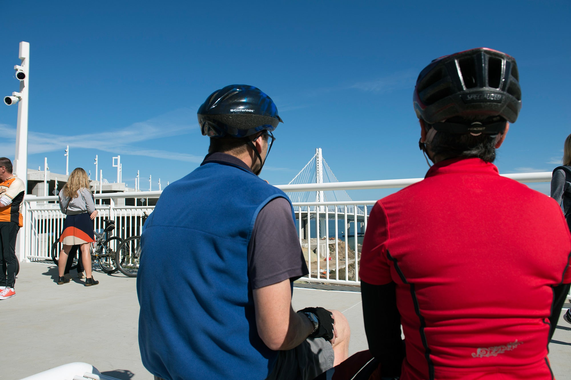 Cyclists take in the view at Yerba Buena Island.