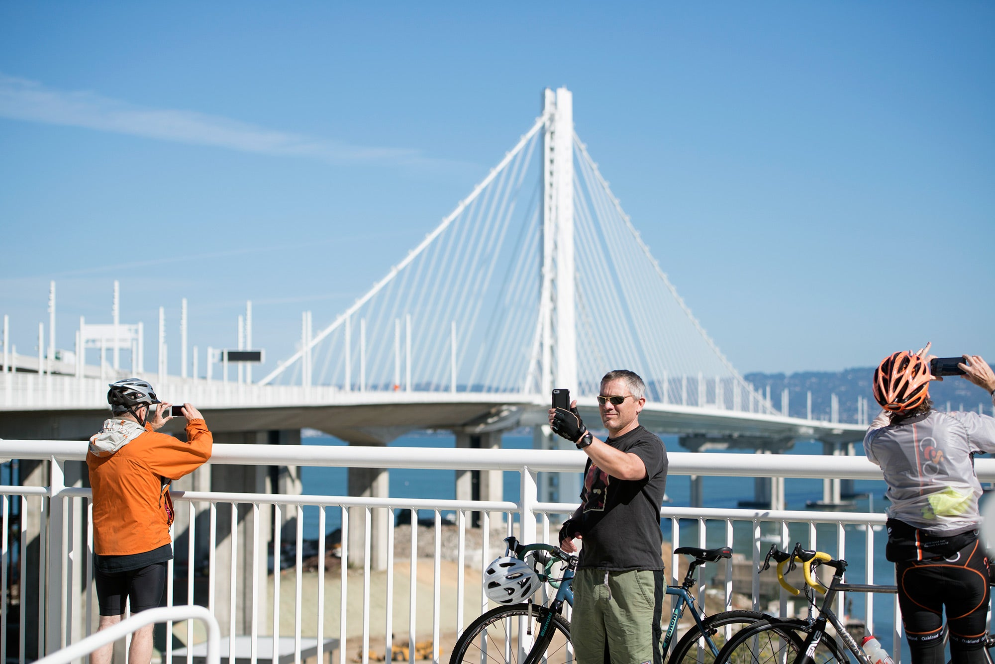 Cyclist takes selfie with East Span tower in the background