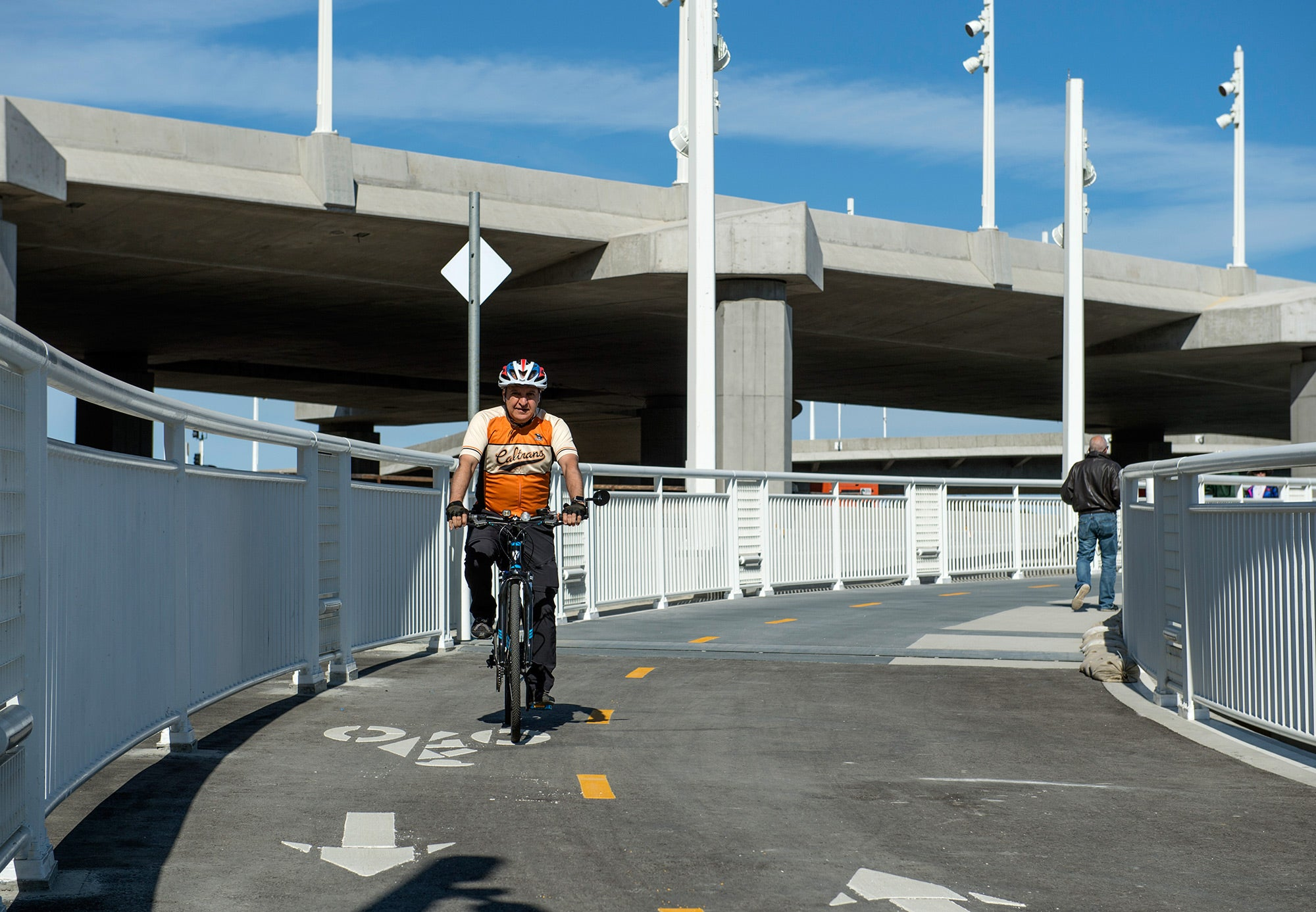 Caltrans District 4 Director (and MTC Commissioner) Bijan Sartipi takes his bike for a spin on the new section of pathway.Walkers and