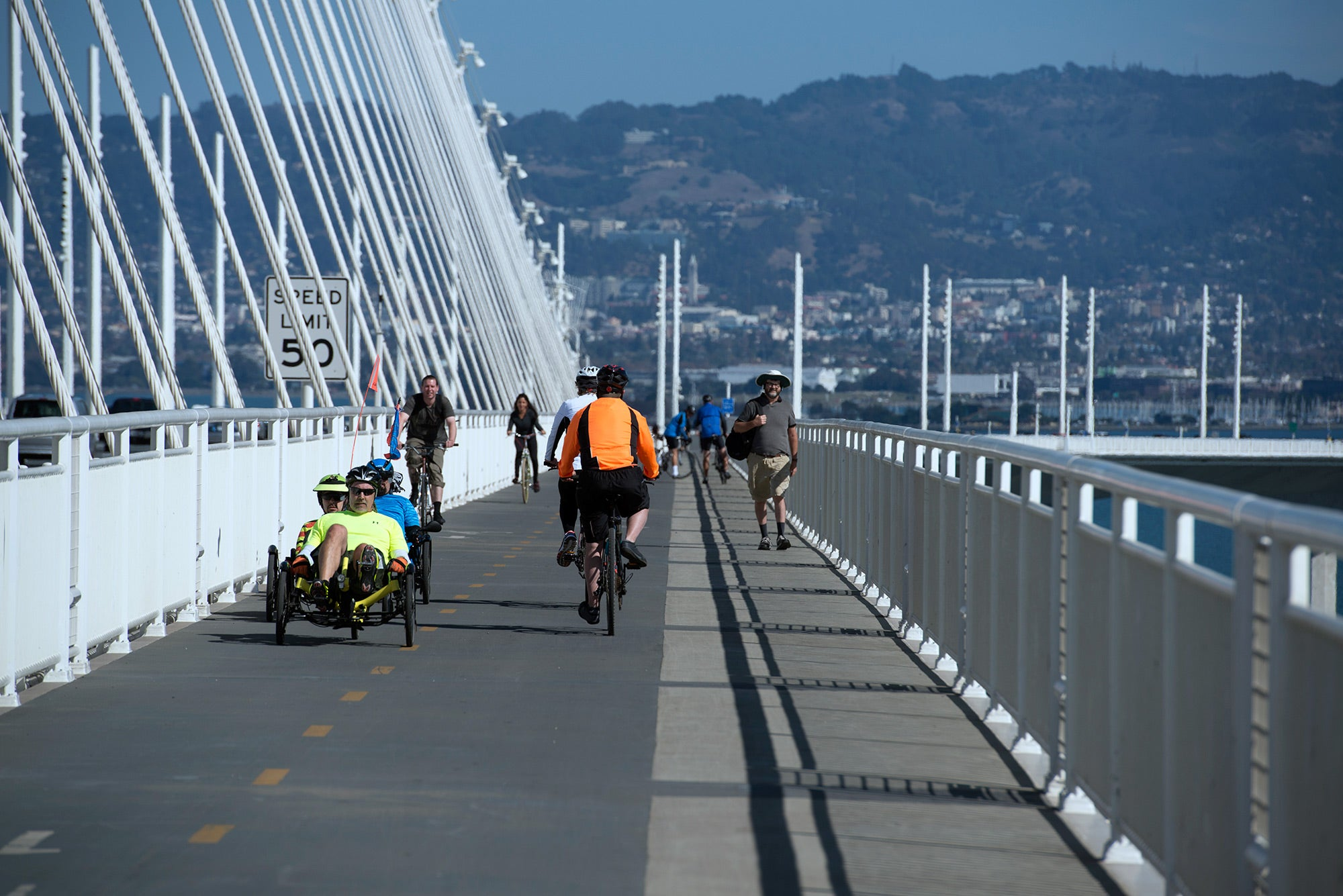 Walkers and cyclists share the path.
