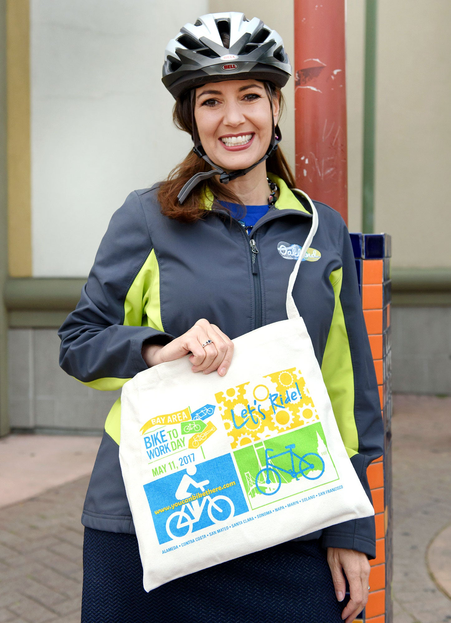 MTC Commissioner and Oakland Mayor Libby Schaaf flashes a Bike to Work Day smile at the Fruitvale BART station