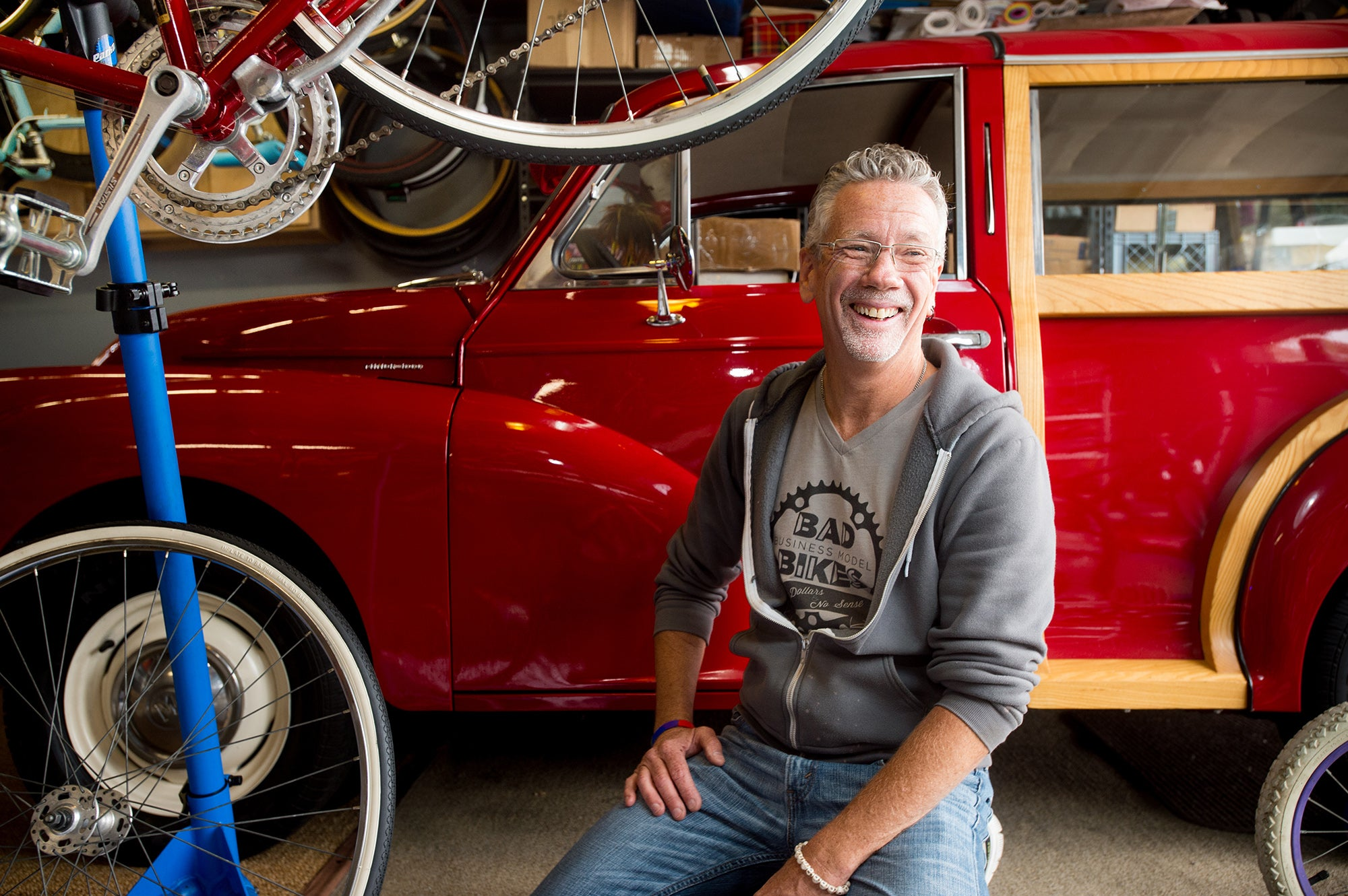 Bill Bradford in his garage with bicycles and a vintage truck