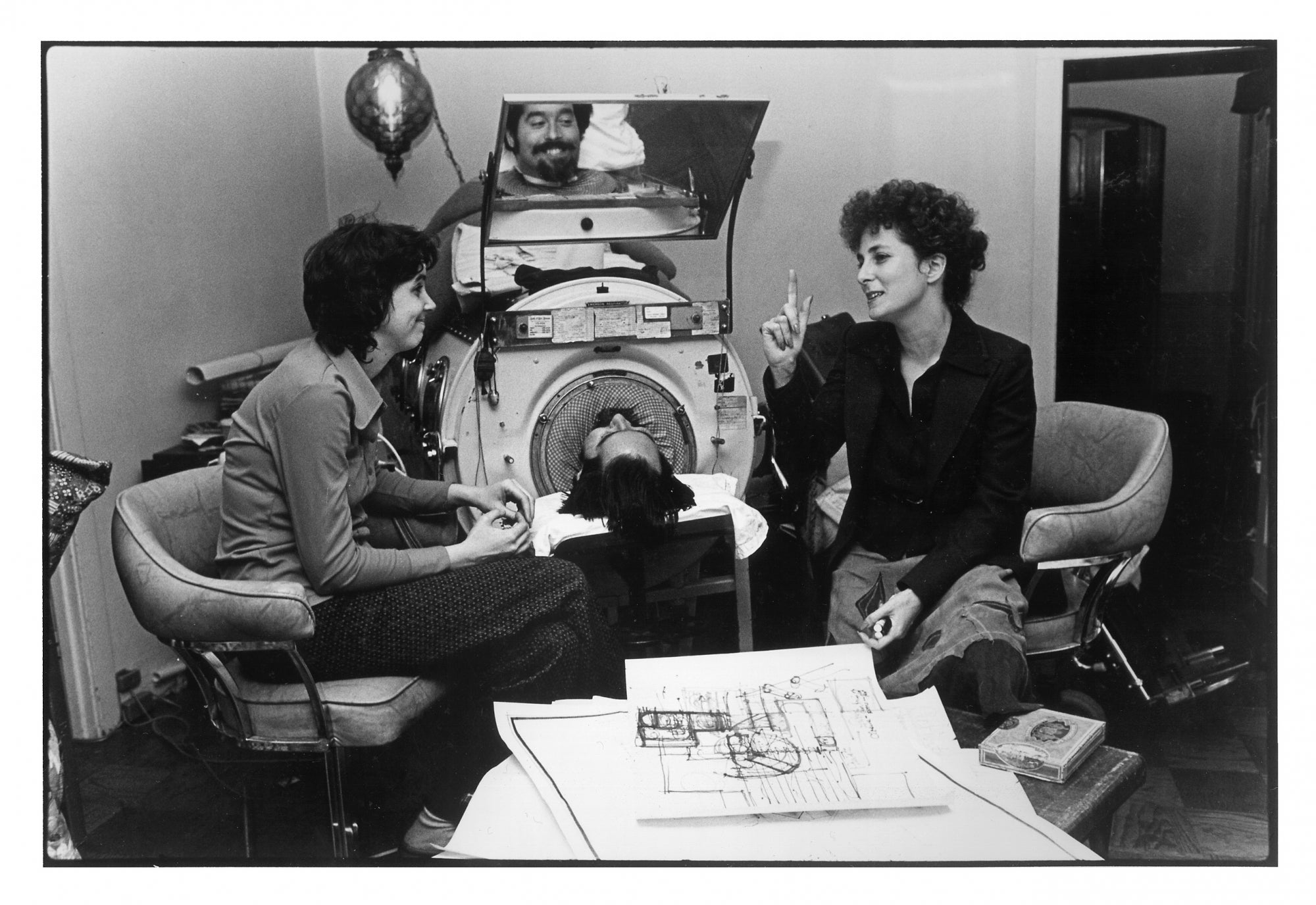 Cathy, Ed and Architect Sally Swanson decide how to renovate their new home so that the iron lung is the center of activity.