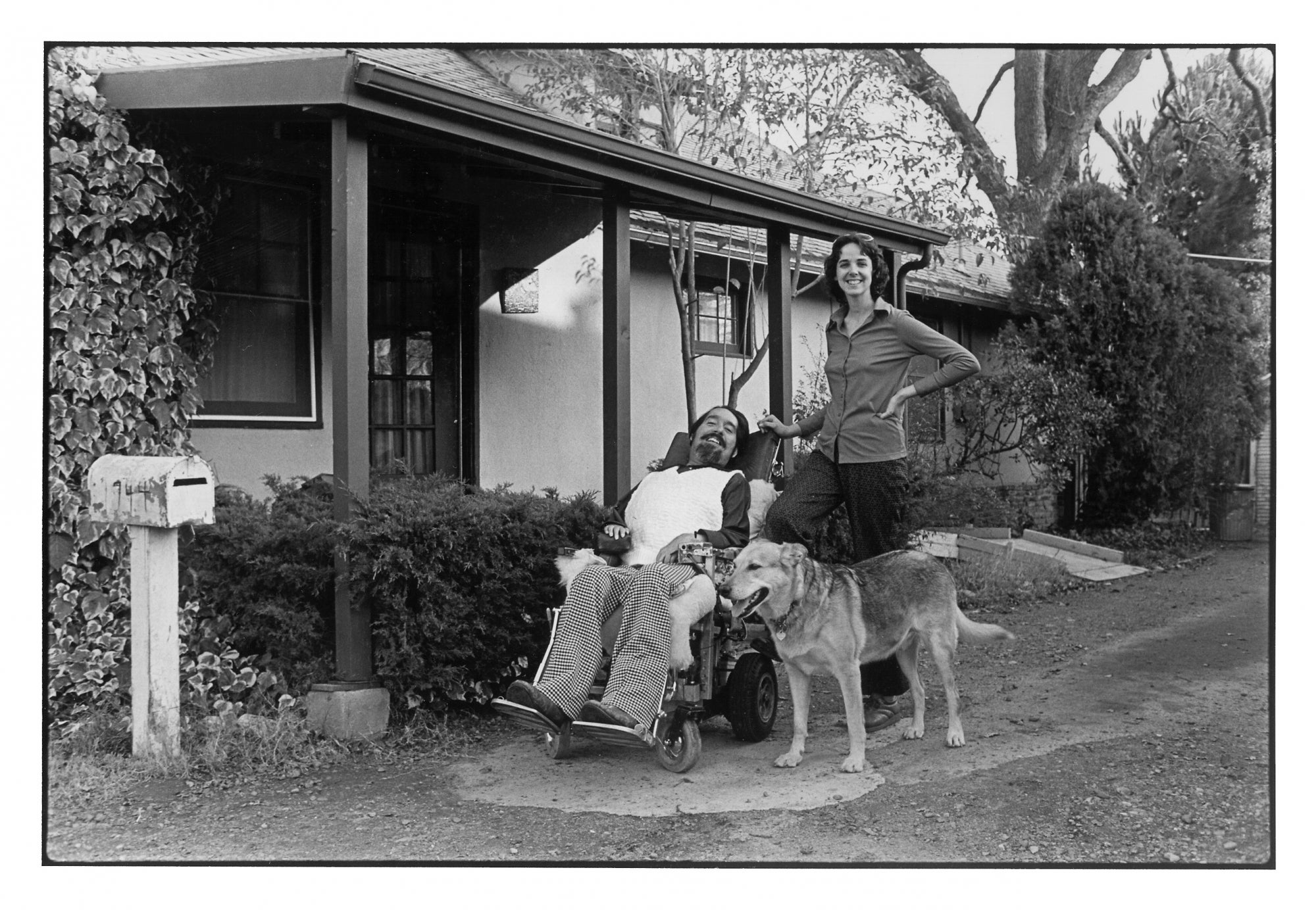 Ed and his wife, Cathy, and their dog Tremor outside their home in Sacramento.
