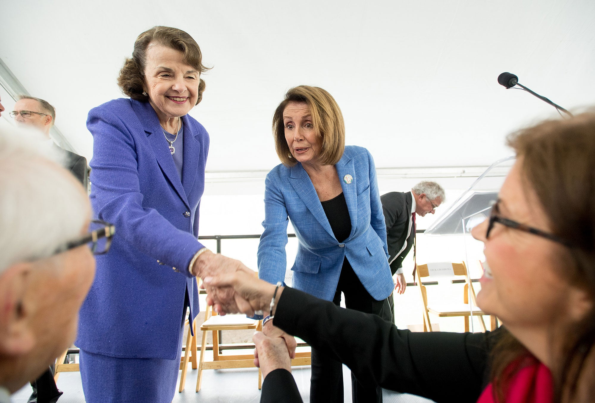Dianne Feinstein and Nancy Pelosi greet the crowd.