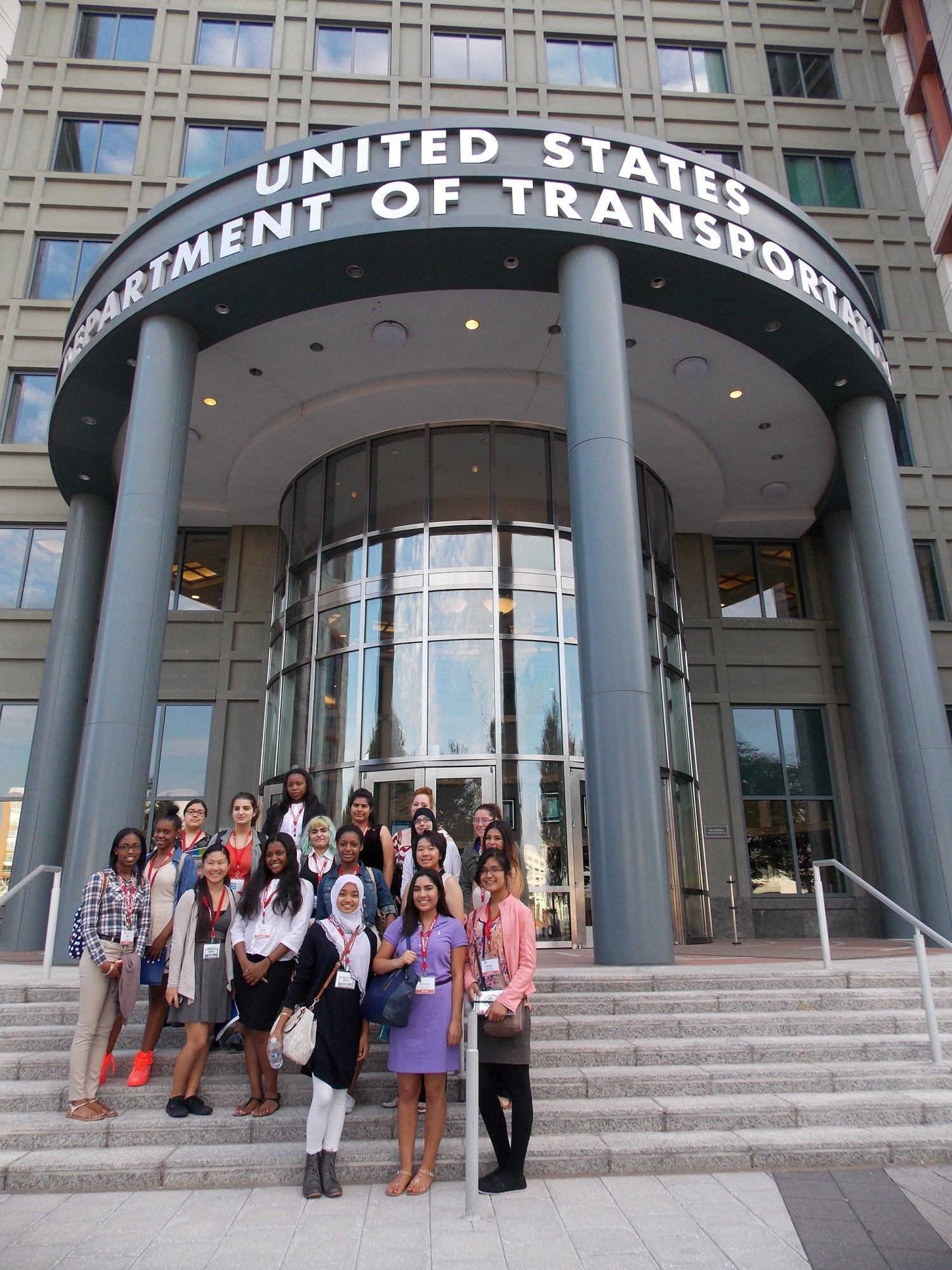 Student participants in Transportation YOU pose for a group photo in front of the Department of Transportation in Washington, D.C.