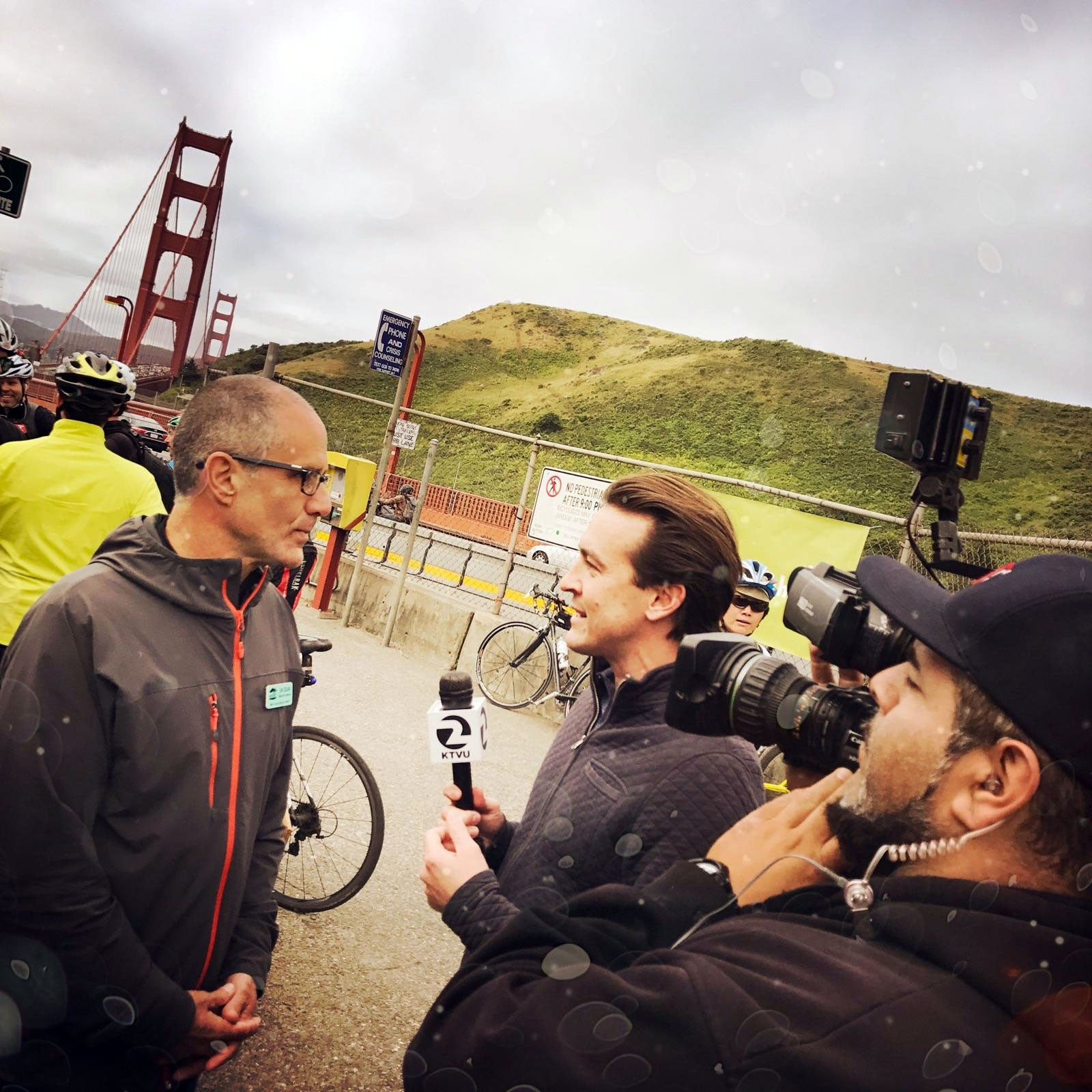 Alex Savidge interviews Jim Elias, Executive director of the Marin County Bicycle Coalition at the Vista Point energizer station.