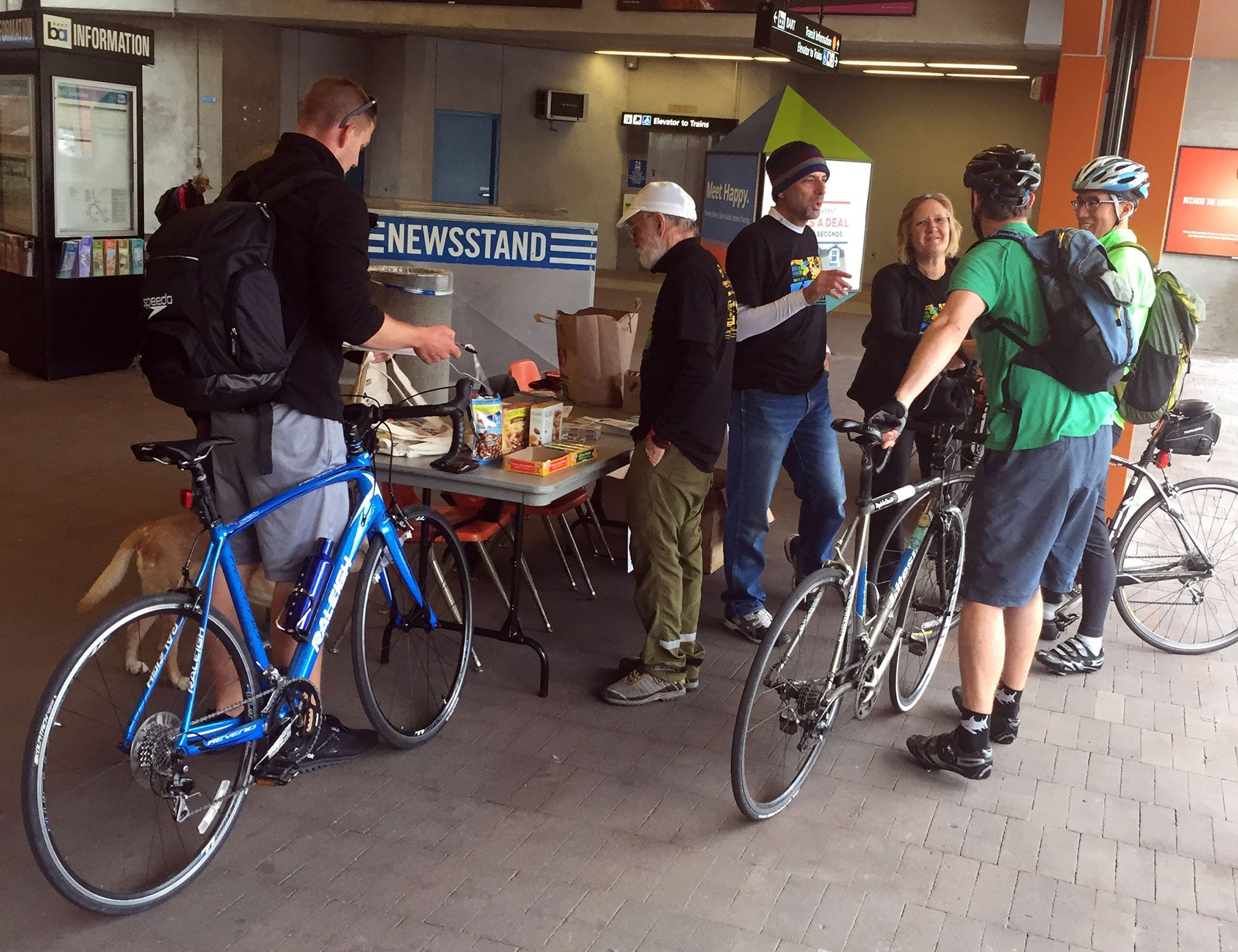 MTC Commissioner and Orinda City Councilmember Amy Rein Worth steps up for volunteer duty at the Energizer Station outside  the Orinda BART station (photo by Julie Teglovich)
