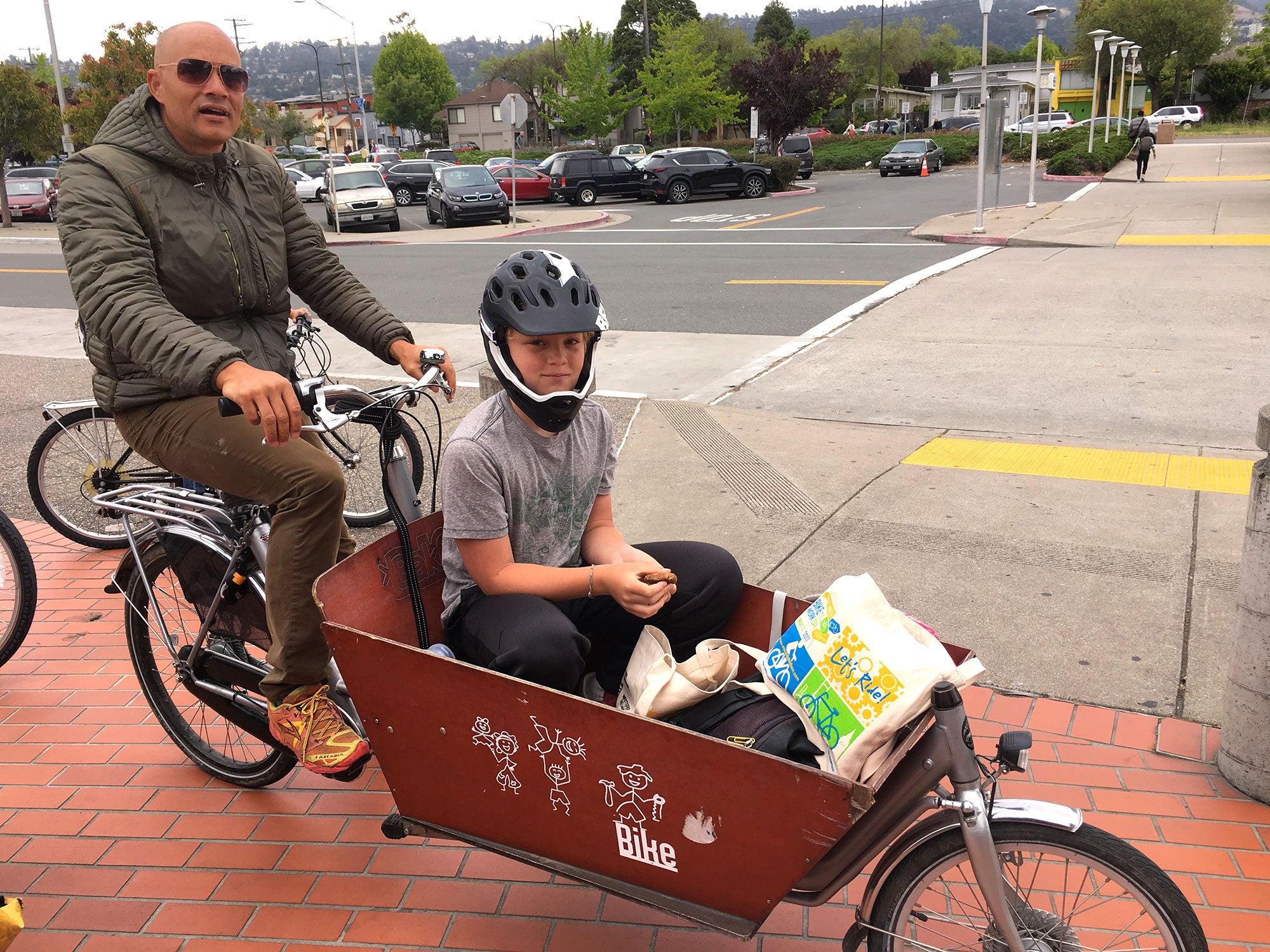 A dad shows off his creative child transport system at the North Berkeley BART Energizer Station.