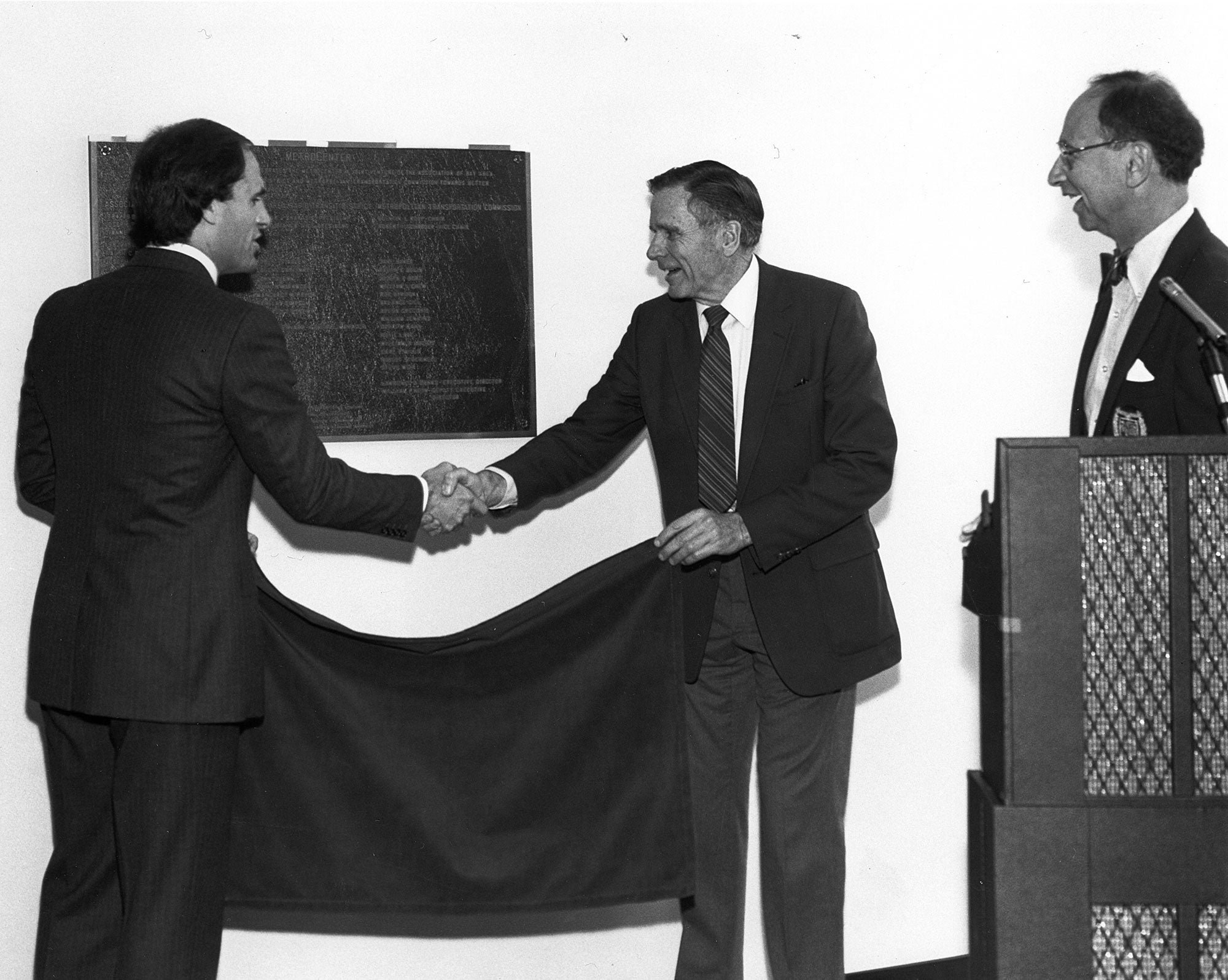 Unveiling a commemorative plaque at the MetroCenter's April 1984 opening ceremony are (left to right) BART Board President Arthur Shartsis, ABAG President and MTC Commissioner (and first MTC Chair) Joseph P. Bort, and MTC Chair Quentin Kopp.