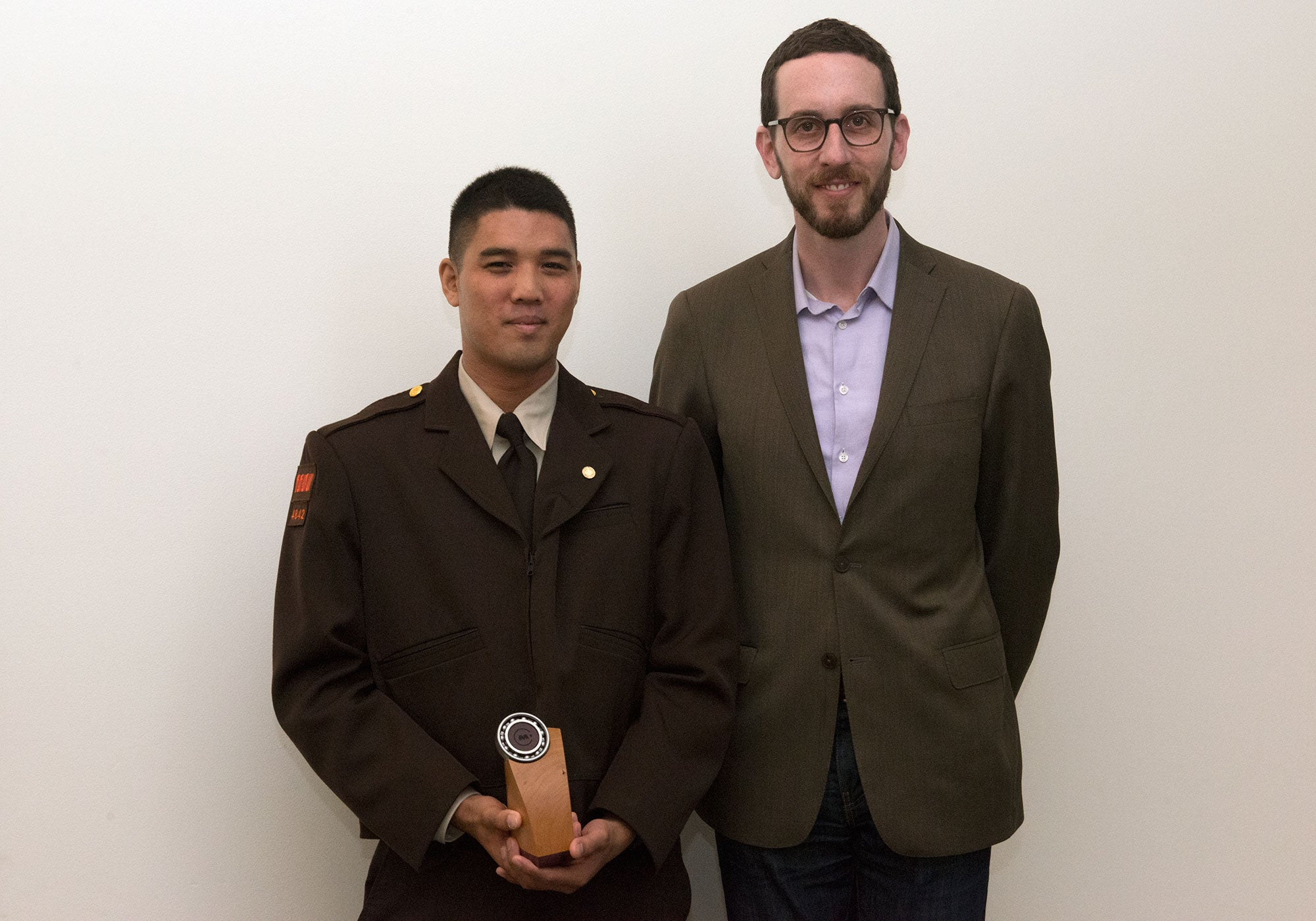 Jose Macasocol poses with MTC Commissioner Scott Wiener after receiving his award trophy