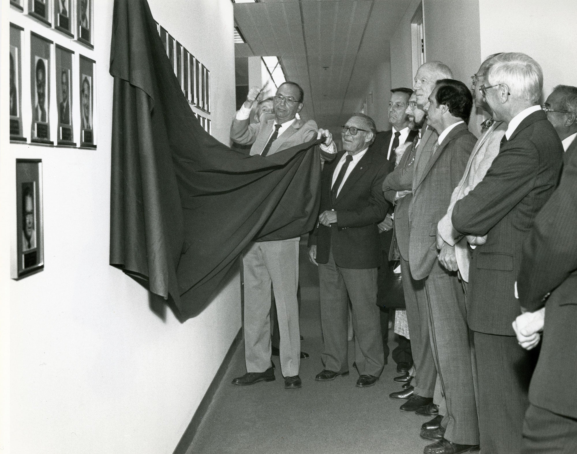MTC commissioners past and present gather in September 1984 for the unveiling of the MTC Former Commissioners Photo Gallery, with Chair Quentin Kopp (left), presiding.