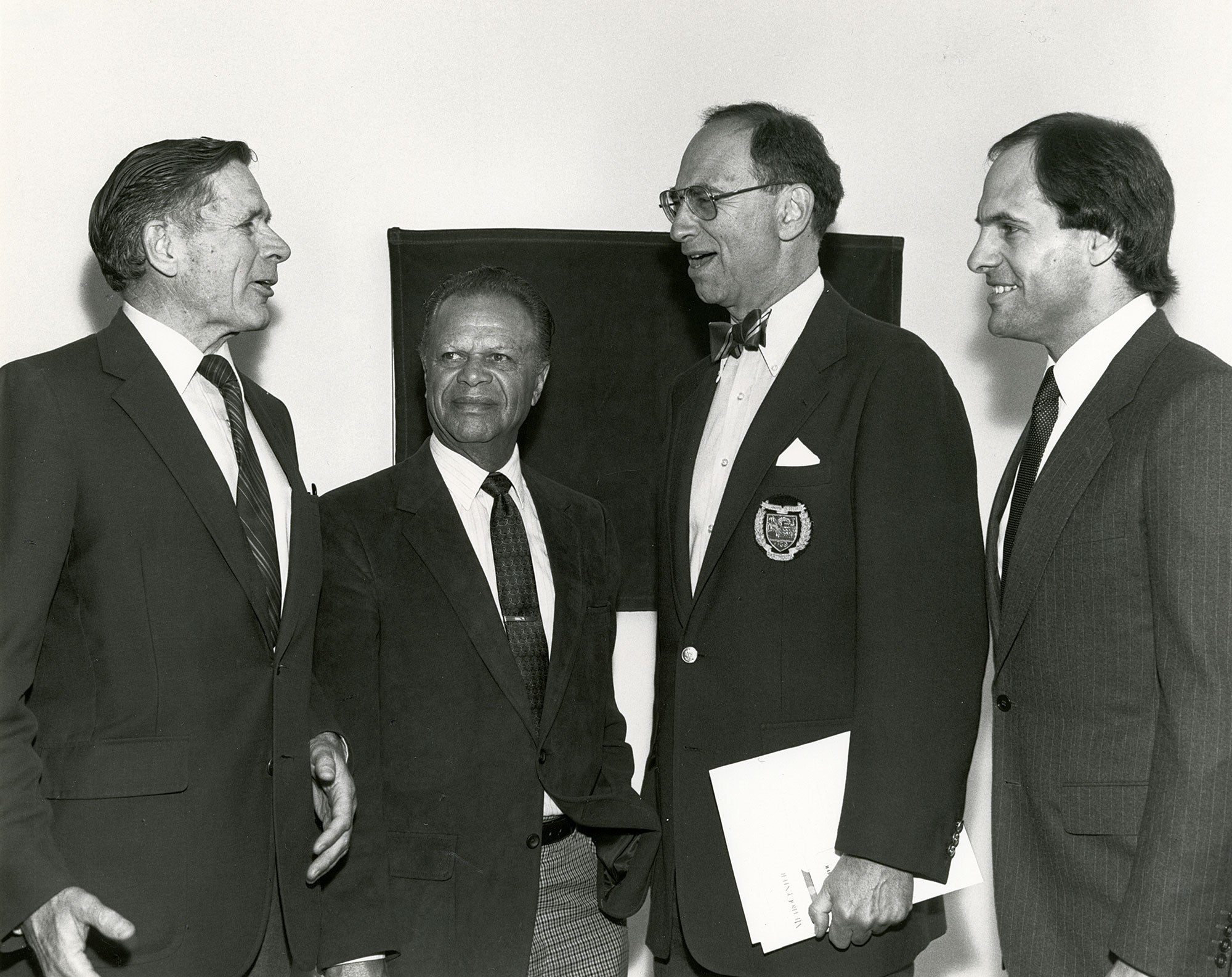 (Left to right) ABAG President and MTC Commissioner Joseph P. Bort, Oakland Mayor Lionel Wilson, MTC Chair Quentin Kopp, and BART Board President Arthur Shartsis converse at the MetroCenter's opening ceremony in April 1984.