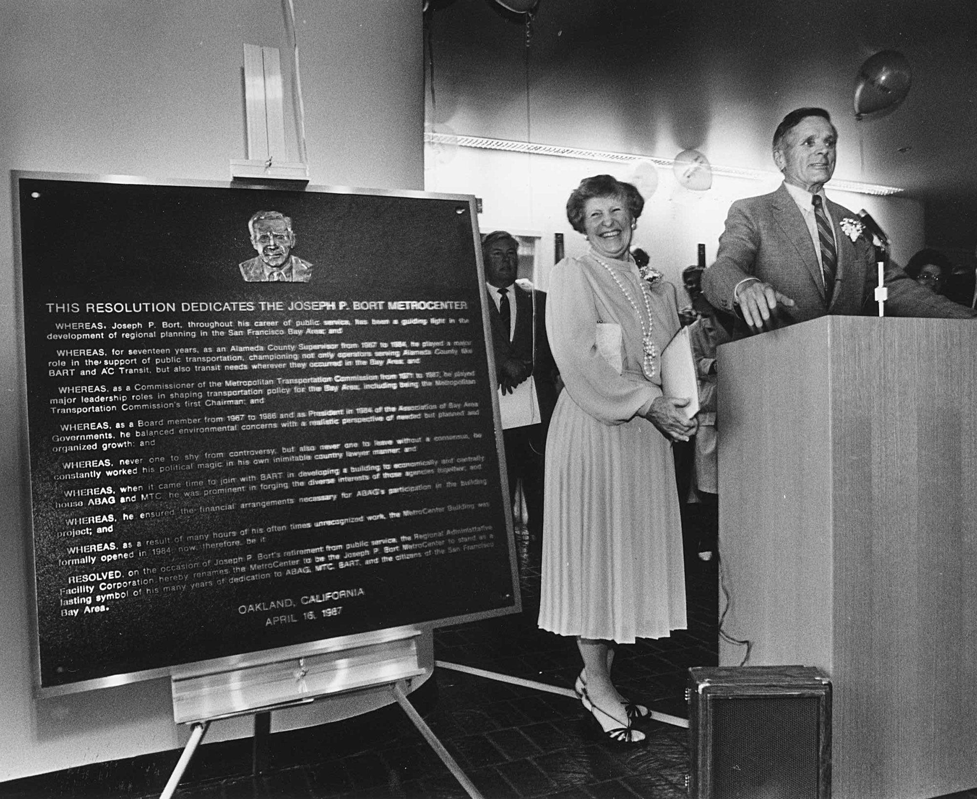 With his wife Jackie at his side, Joseph P. Bort speaks to the crowd at the April 1987 unveiling of the plaque dedicating the MetroCenter in his name.