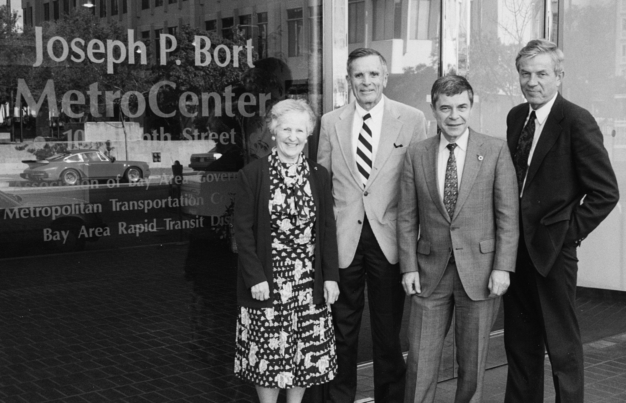 Showing off the newly etched glass gracing the front of the Joseph P. Bort MetroCenter are (left to right) Jackie Bort, Joseph P. Bort, ABAG Executive Director Revan Tranter and MTC Executive Director Lawrence D. Dahms.