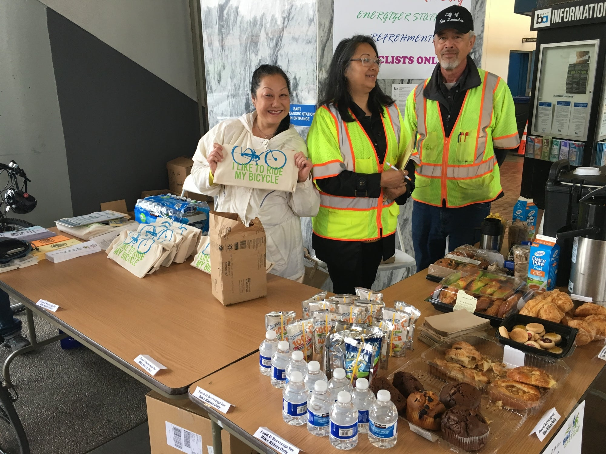 Staff at the San Leandro BART energizer station show off their goodies.