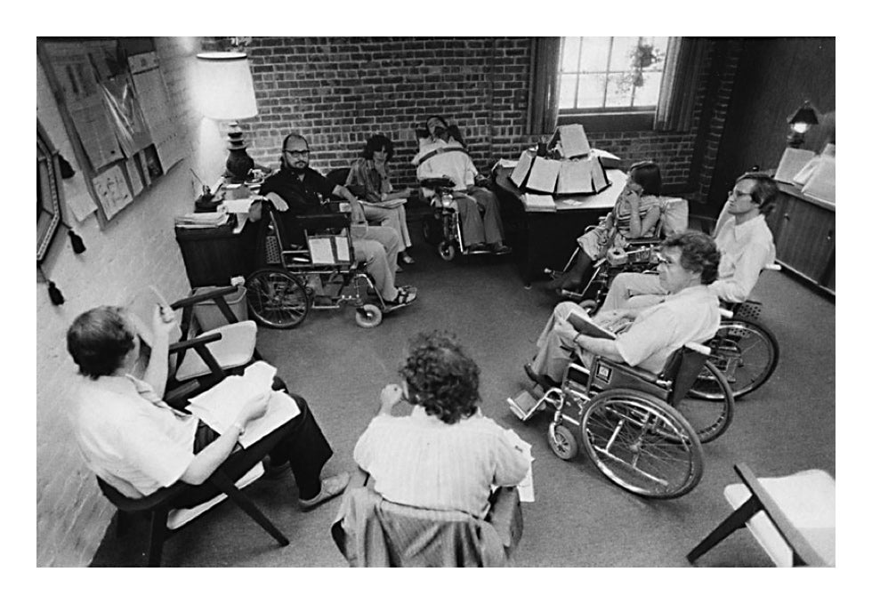 Ed with his top staff in his office in Rehab