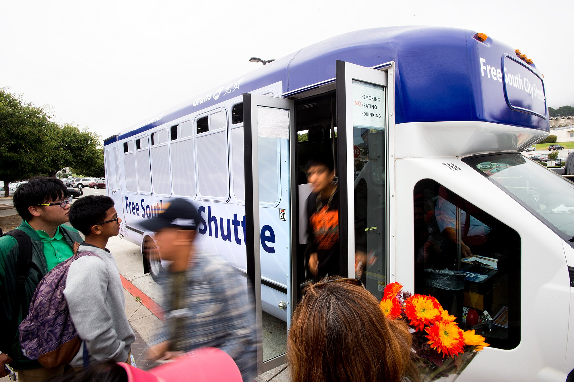 Young people exit the free South San Francisco community shuttle.