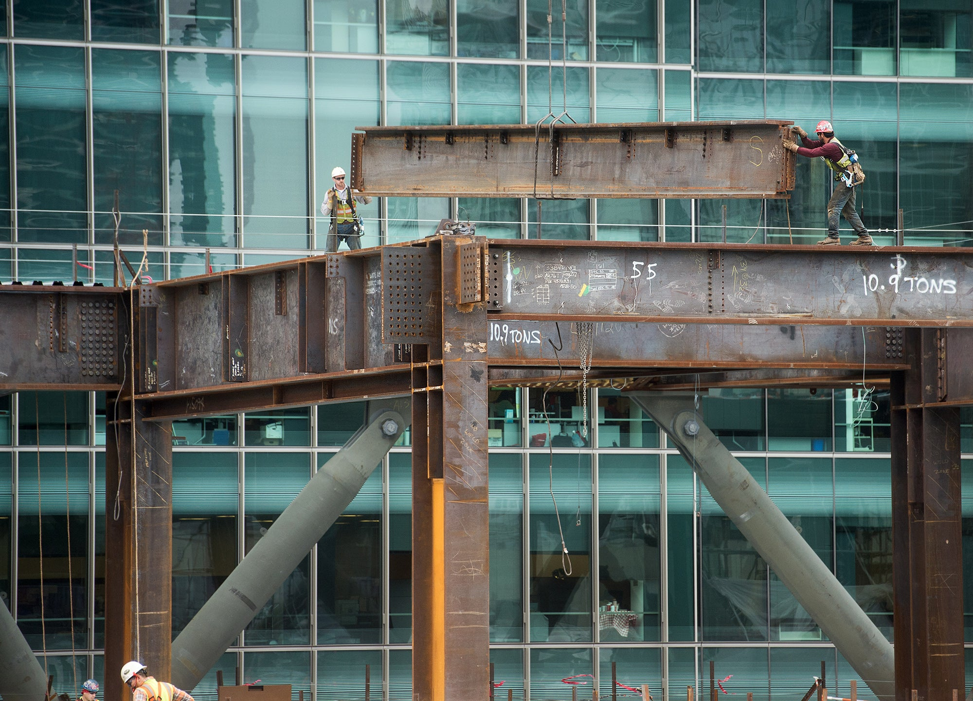 Workers erect the support beams for the Transbay Terminal
