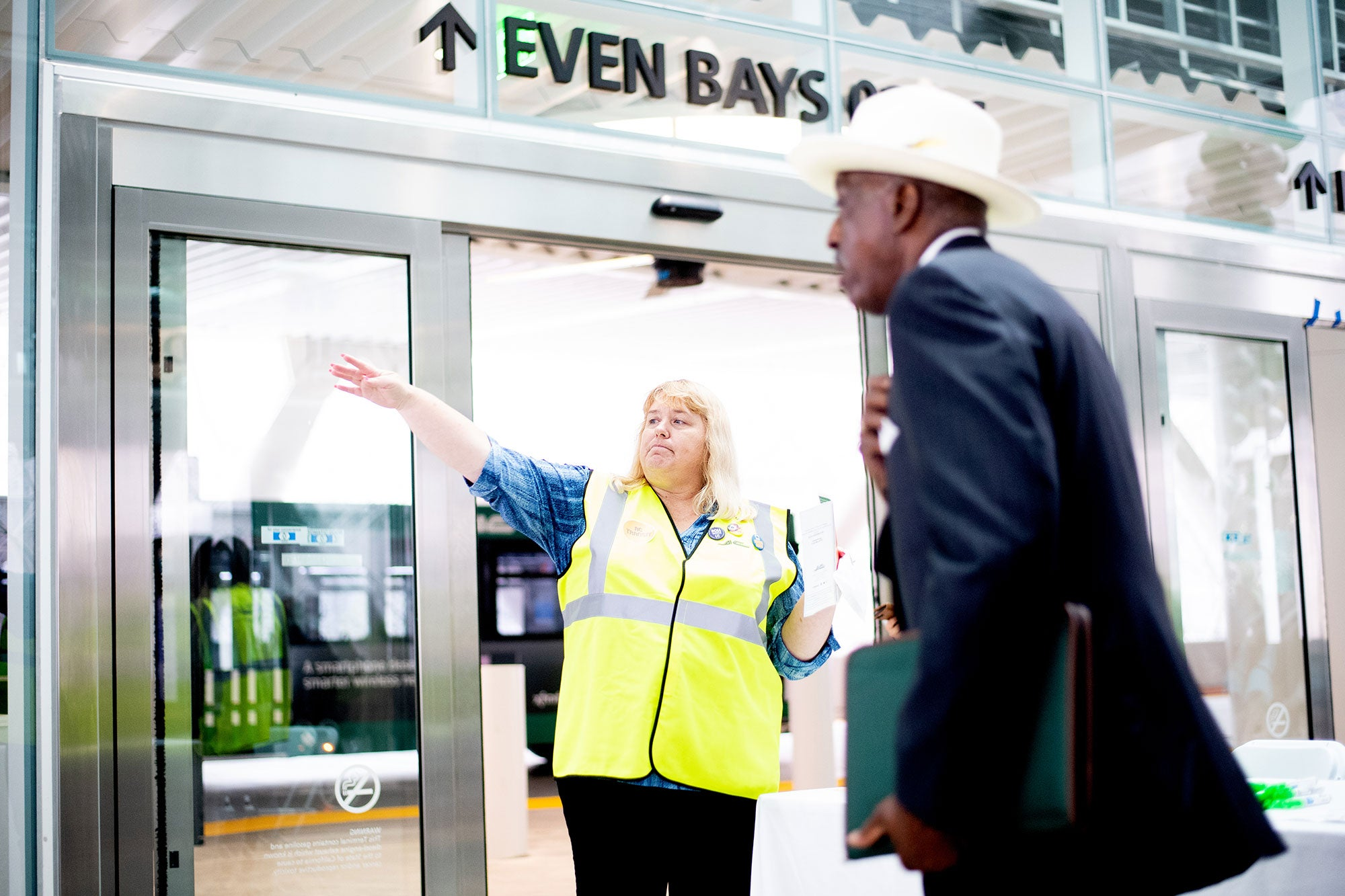 AC Transit ambassador Tammy Kyllo helps a commuter navigate the Salesforce Transit Center during the first day of AC Transit Service