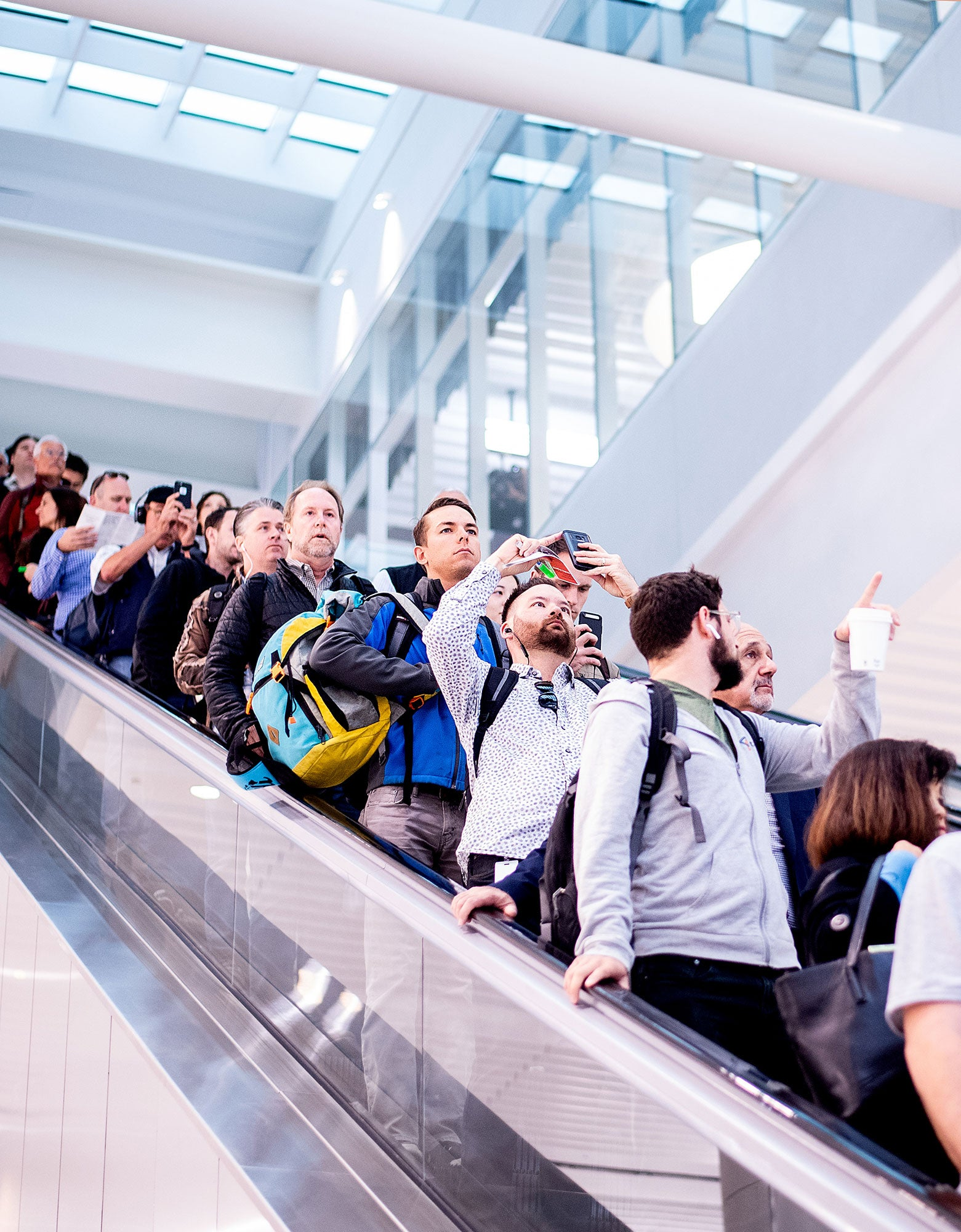 Commuters photograph the Oculus as they disembark at the Salesforce Transit Center during the first day of AC Transit service