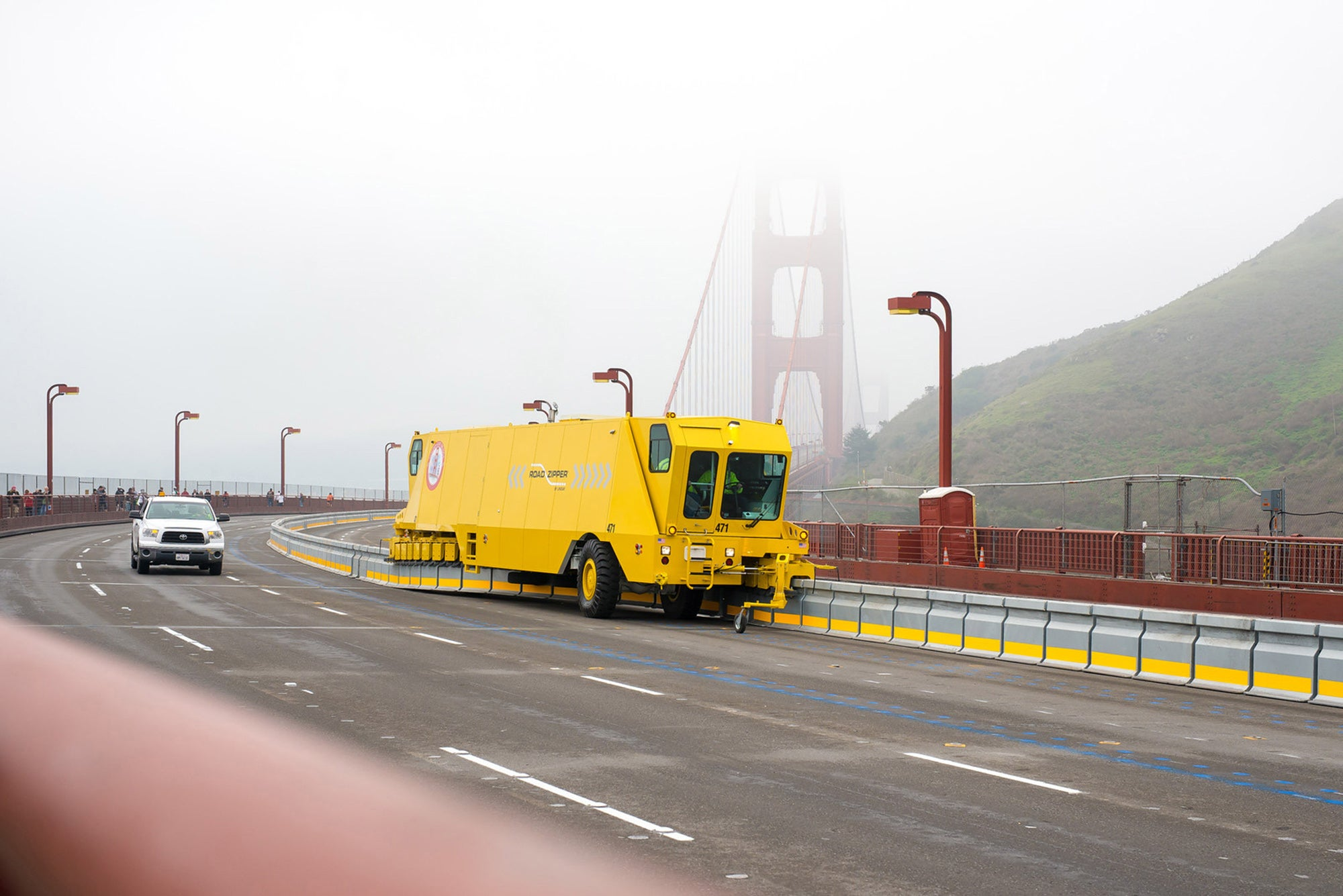 Zipper truck moves the barrier on a foggy Golden Gate Bridge