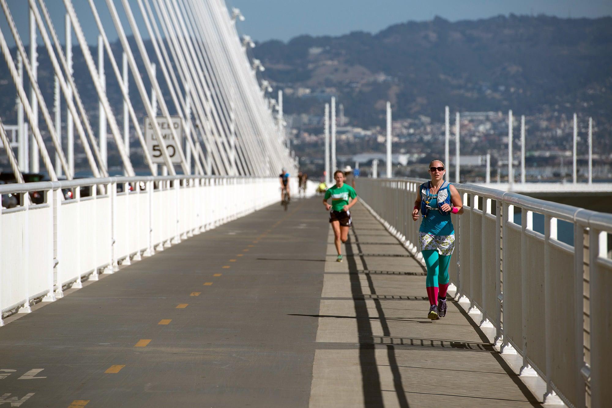 Woman running across new path