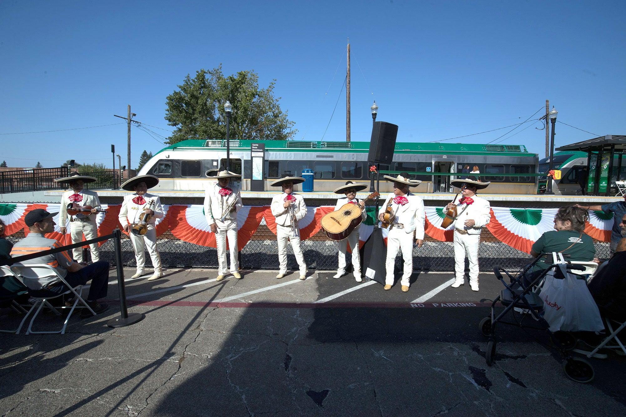 mariachi band plays