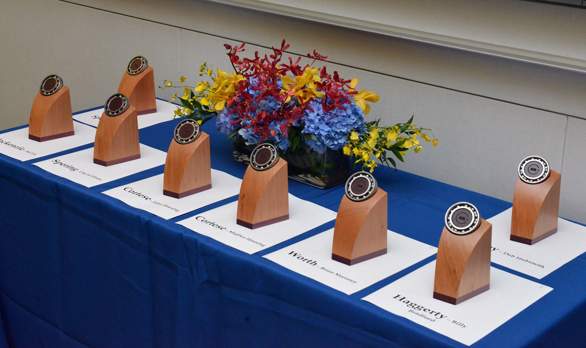 MTC Transportation Awards trophies sit on a table, each labelled with the name of the award presenter and winner.
