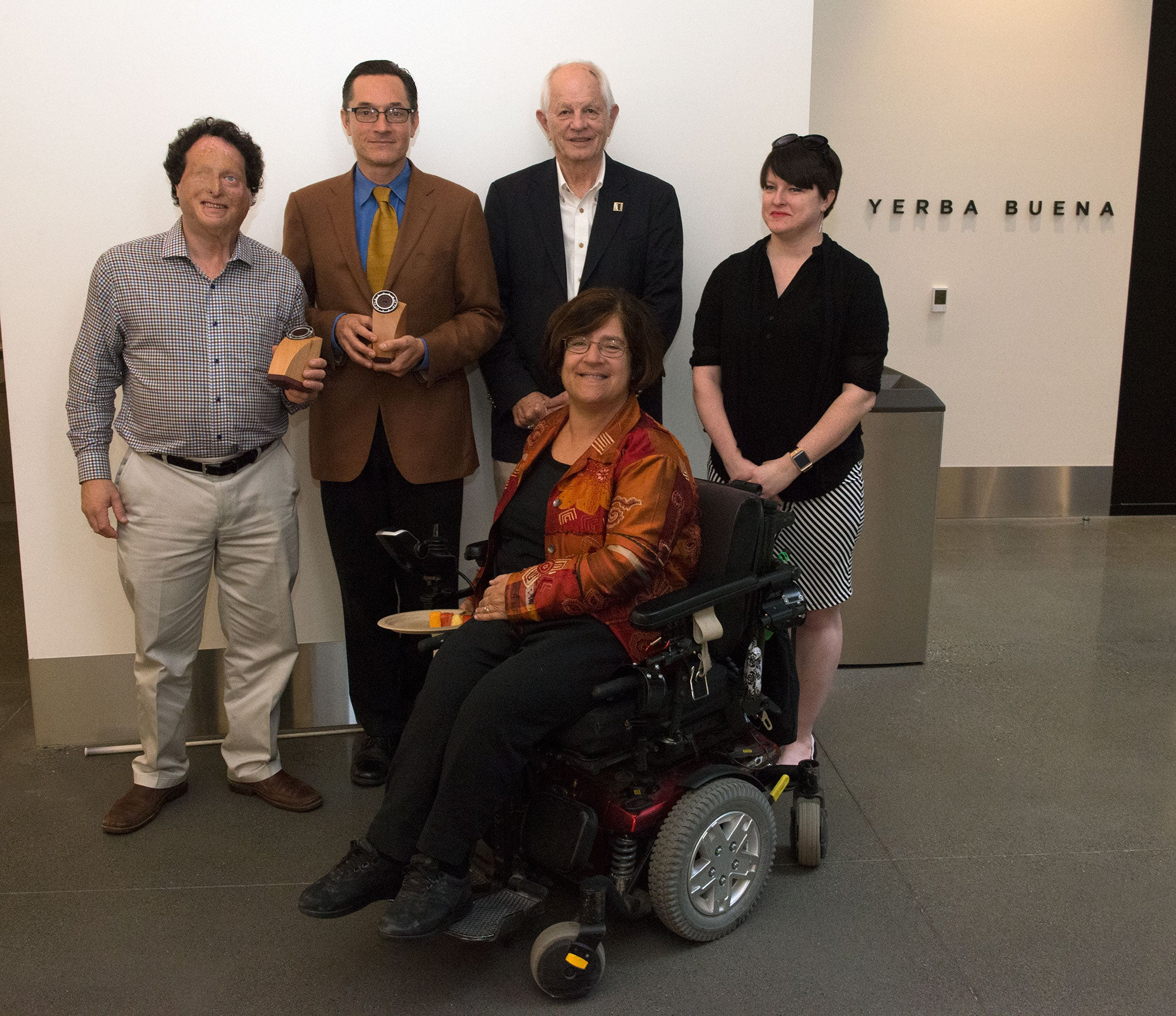 2016 Doris W. Kahn Accessible Transportation Award winners Dr. Joshua Miele and Greg Kehret pose for a photo with MTC Commissioners Tom Bates and Dorene Giacopini