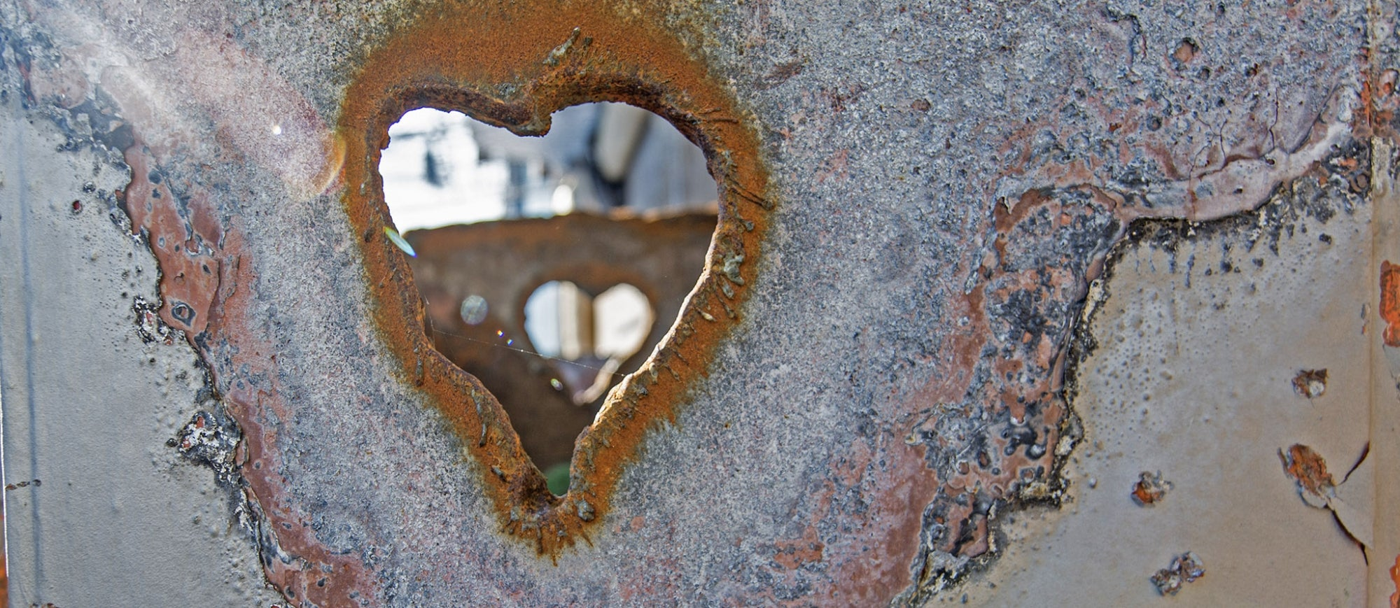 heart-shaped hole in a piece of salvaged steel