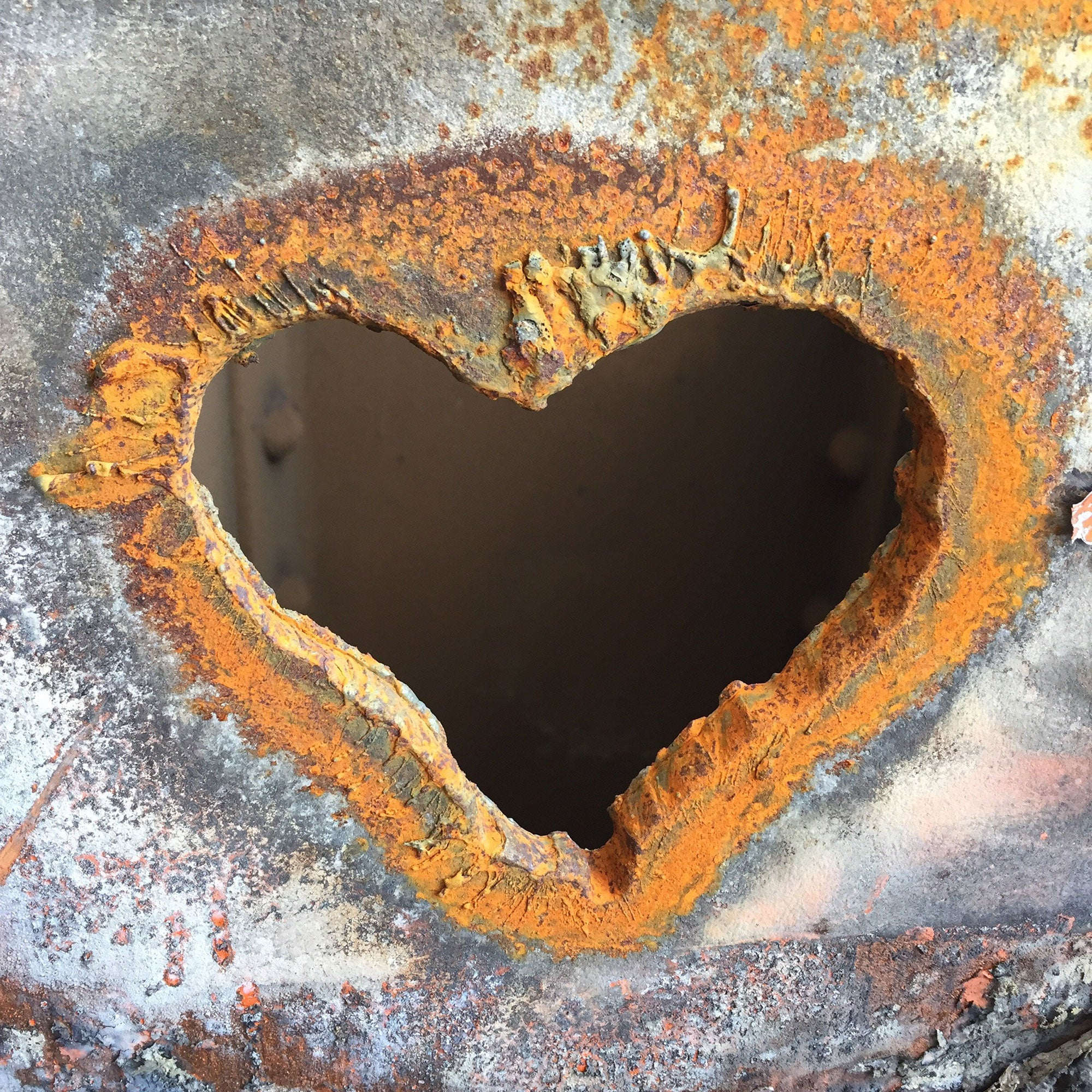 Viewed here is a slab of steel in which a heart shape has been torched.
