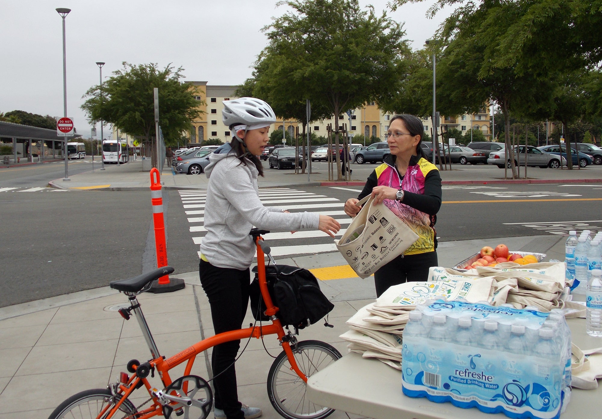 Bike to Work Day messenger bags and healthy fruit snacks were the offerings at the Union City BART Energizer Station.